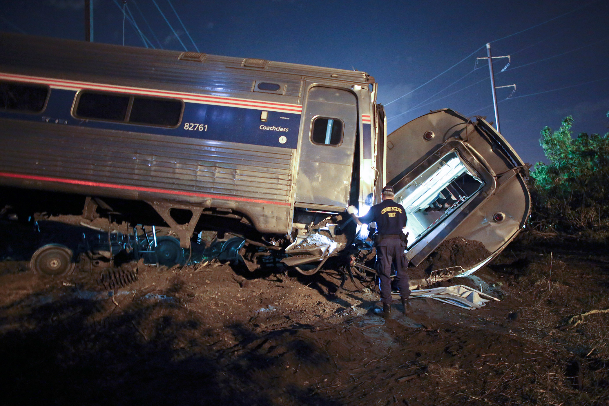 Emergency personnel work at the scene of an Amtrak train wreck on May 12, 2015, in Philadelphia.