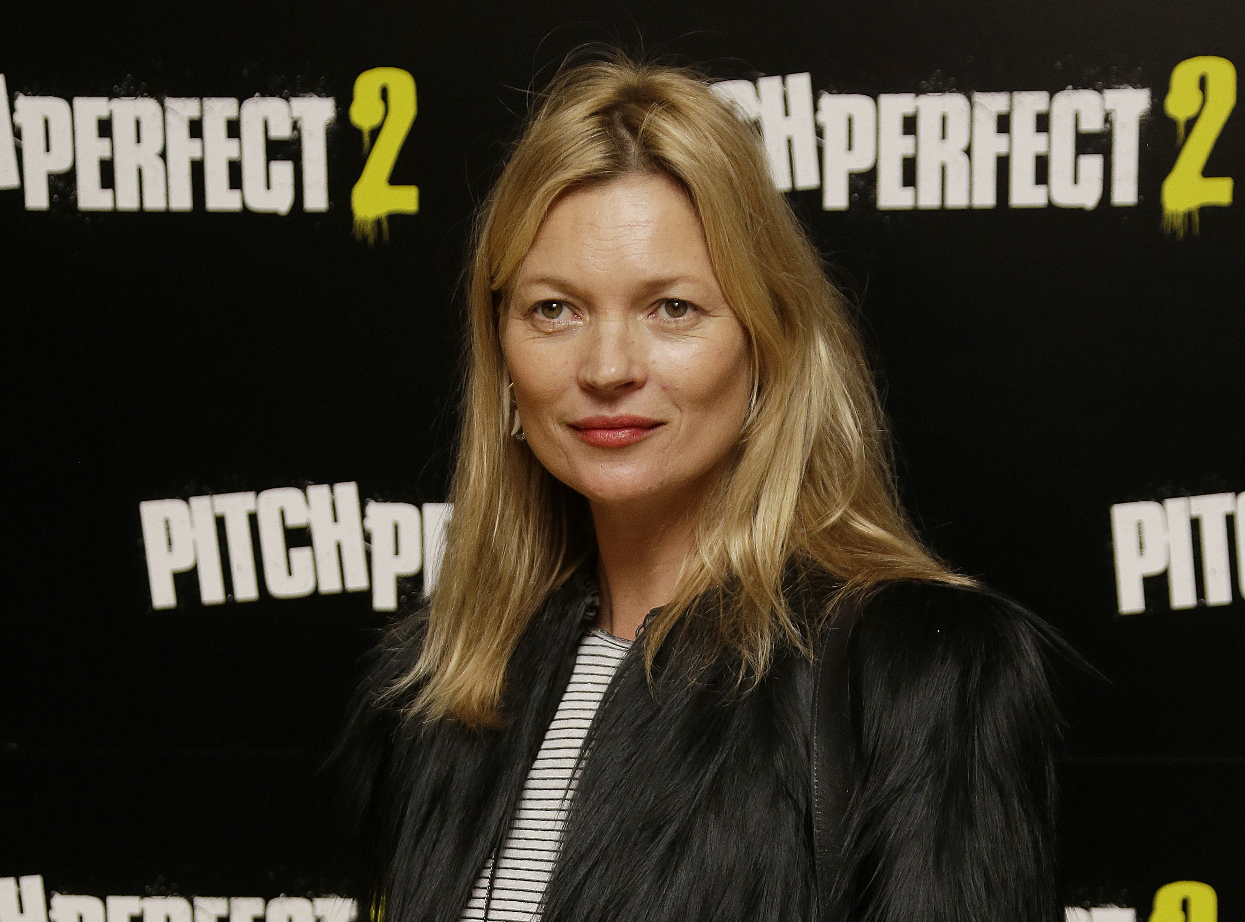 Kate Moss poses for photographers at the screening of Pitch Perfect 2 in central London.