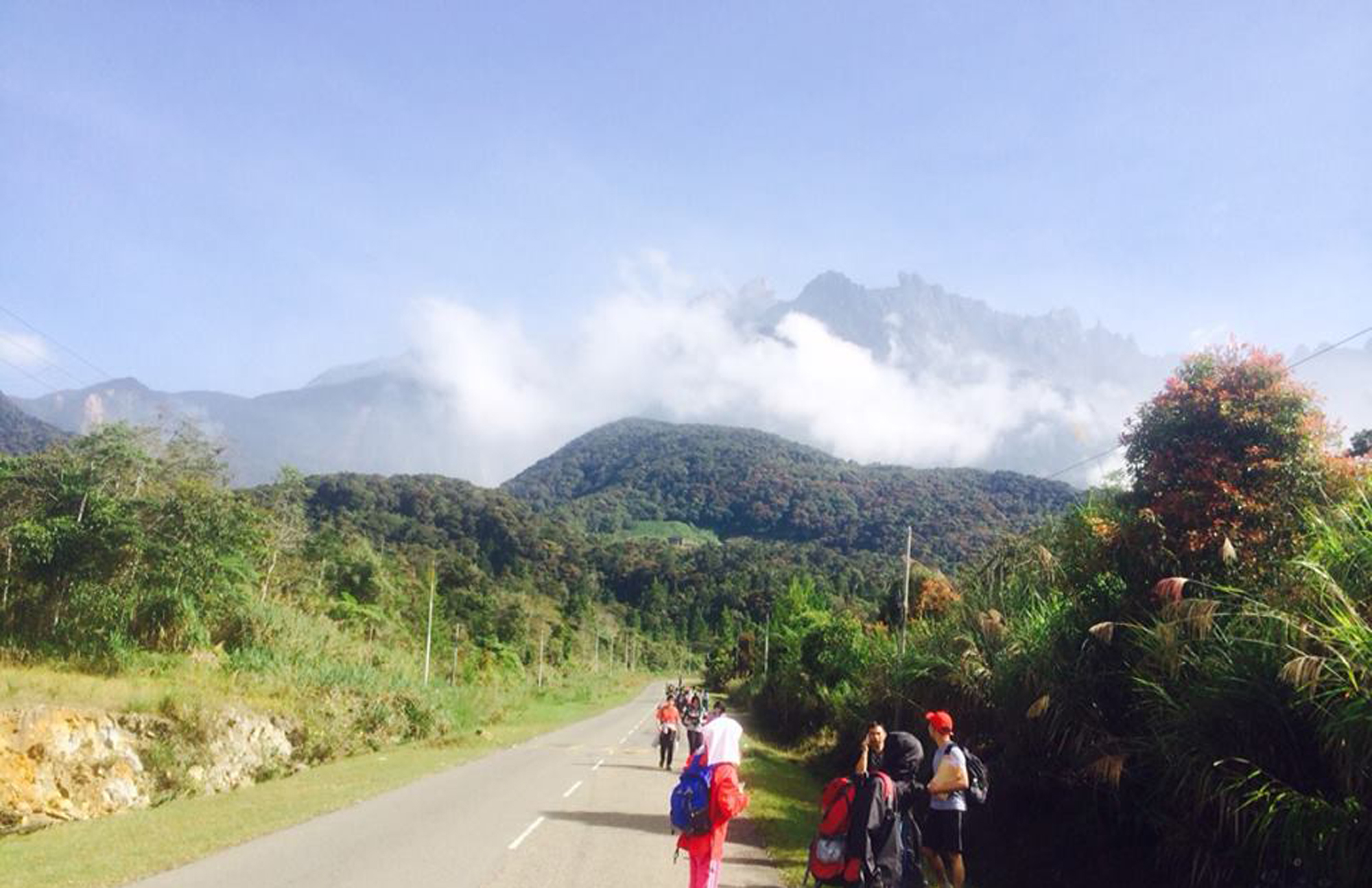 Tourists walk away from Mount Kinabalu hours after a magnitude 5.9 earthquake shook the area in Kundasang, Sabah, Malaysia, June 5, 2015.