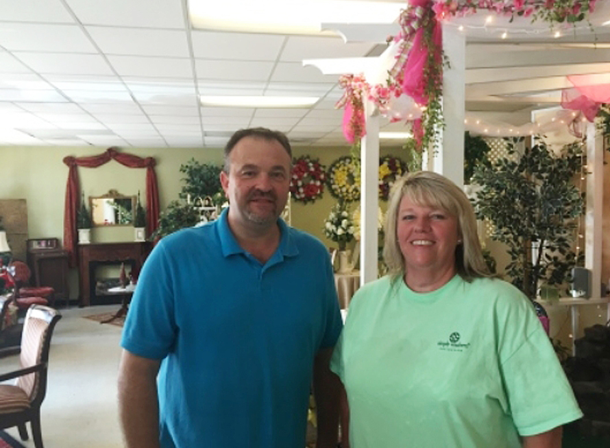 Todd Frady, left, and Debbie Dills of Frady's Florist in Kings Mountain, N.C., pose for a photo after Dills called in the tip that ultimately led to the arrest of Dylann Storm Roof, on June 18, 2015