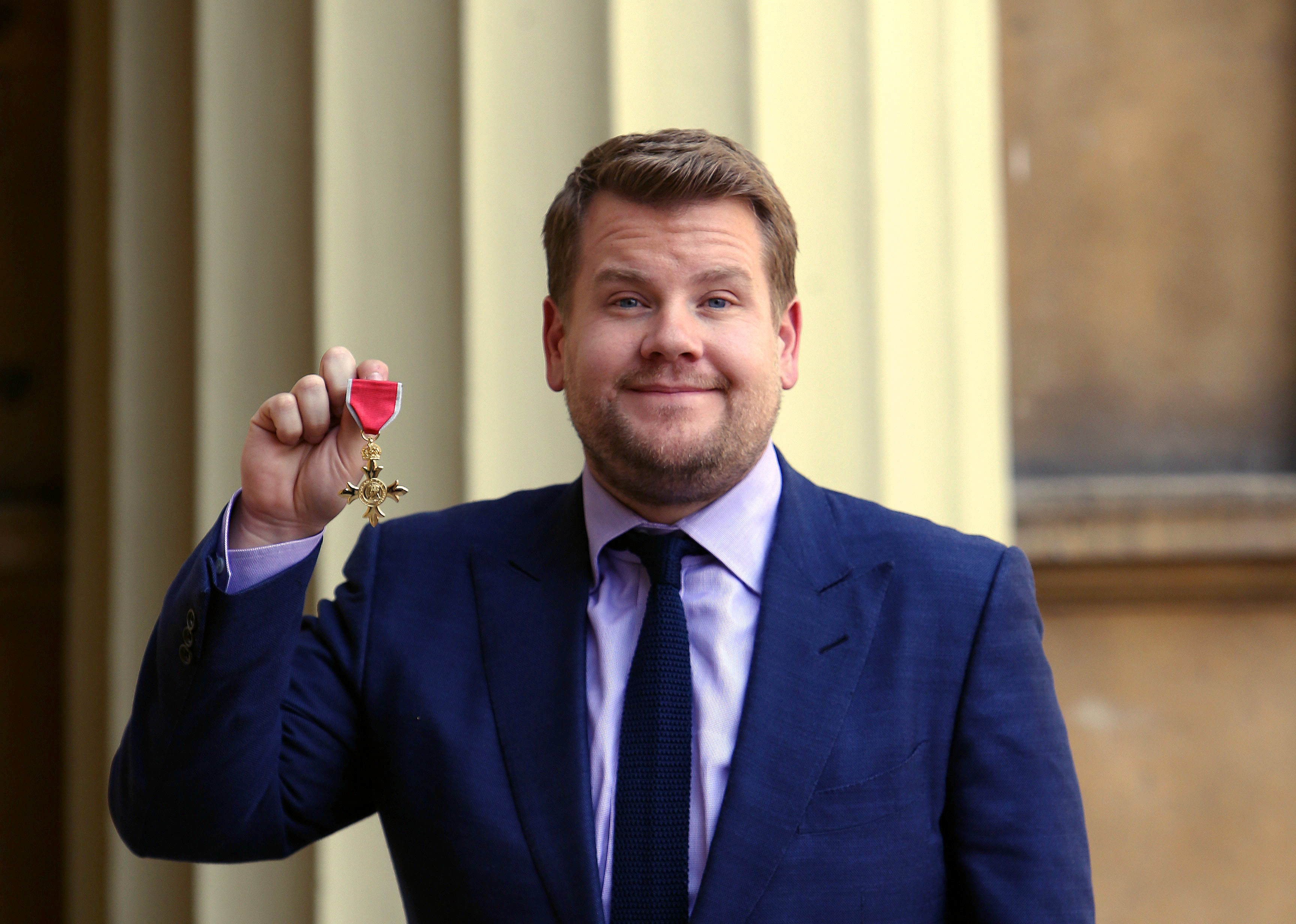 Investitures at Buckingham Palace. James Corden after being awarded an OBE by the Princess Royal at an investiture ceremony at Buckingham Palace, London. Picture date: Thursday June 25, 2015