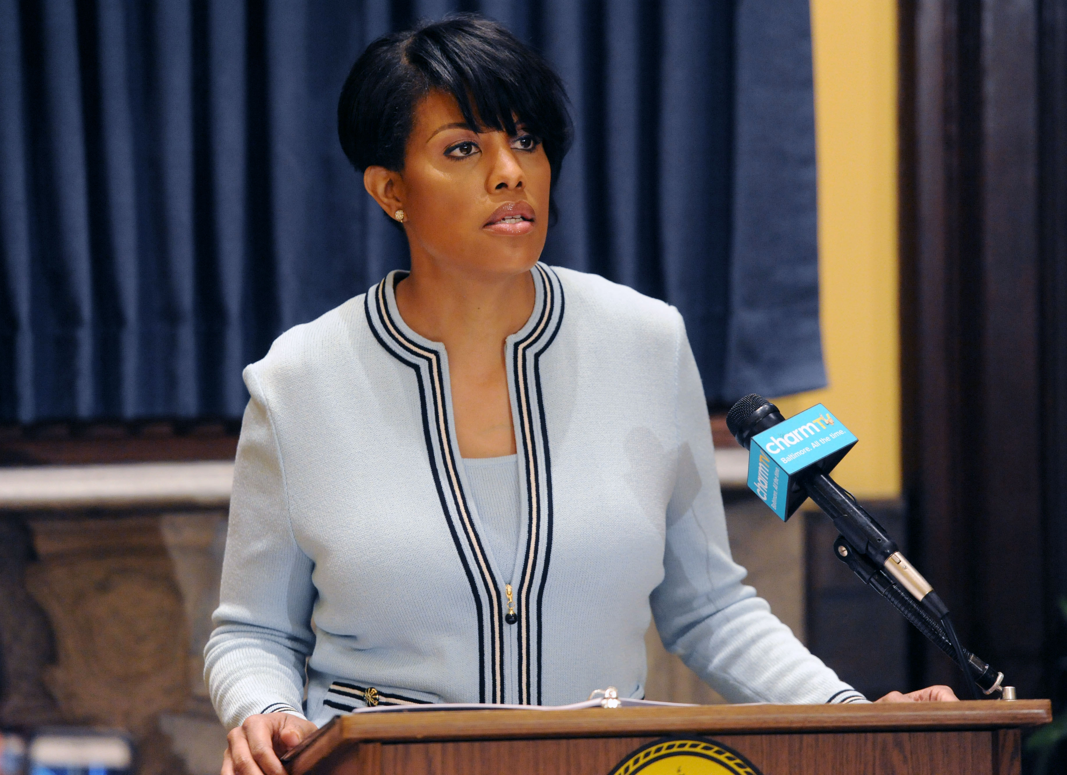 A new report suggests that Baltimore won't fully equip its police officers with body cameras for four years. Mayor Stephanie Rawlings-Blake, shown here at a May 6, 2015, news conference, says she wants them implemented by 2016.