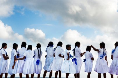 School girls looking out to sea in Galle Port, Sri Lanka.
