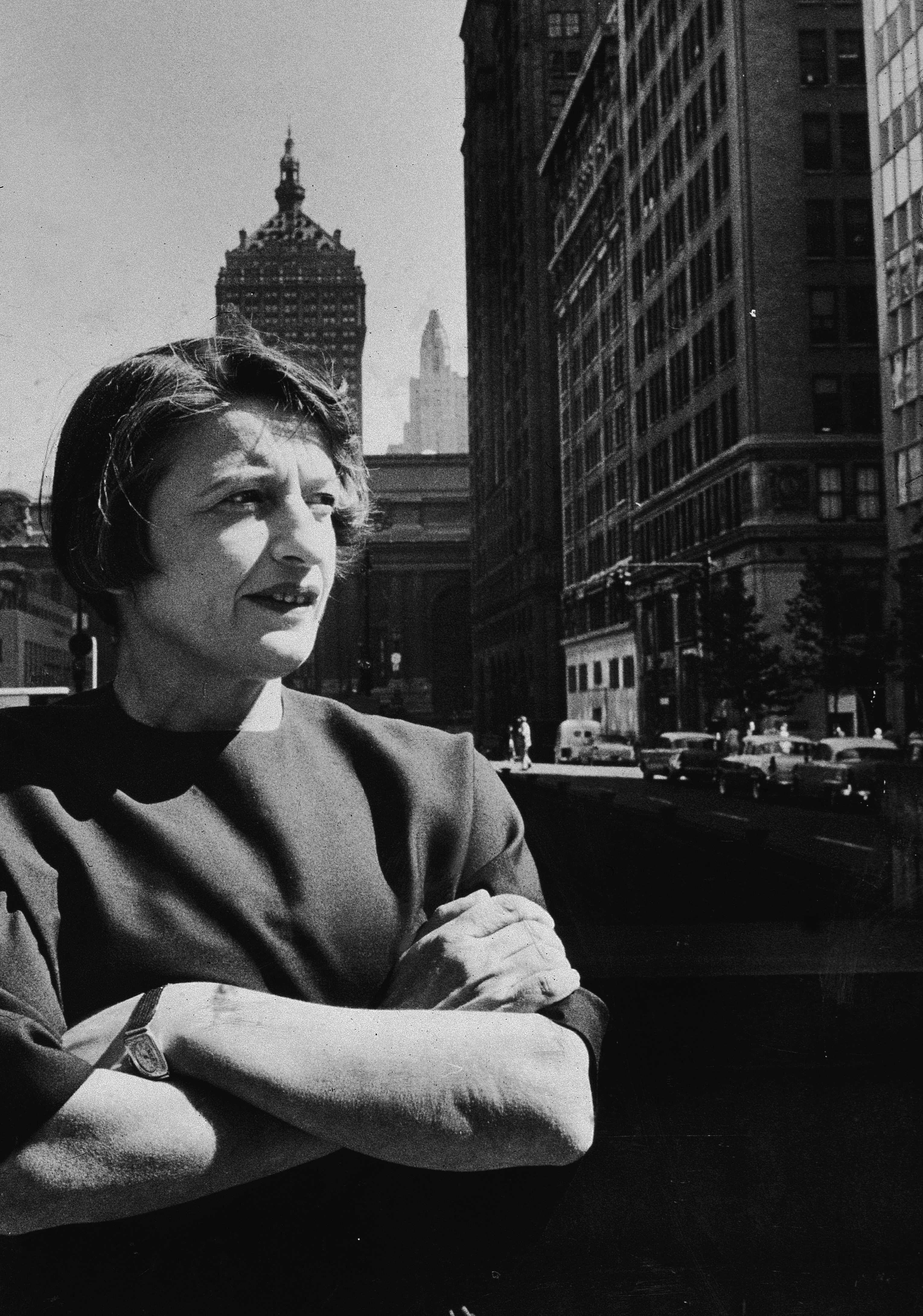 Ayn Rand stands with her arms folded on a street in New York City in 1957.