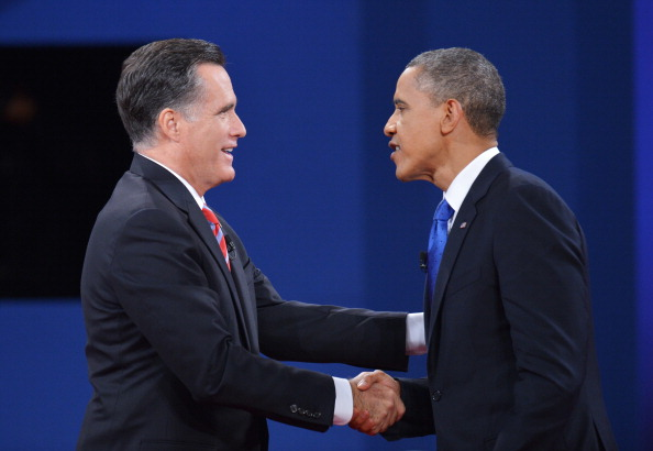 US President Barack Obama shakes hands with Republican presidential candidate Mitt Romney at the end of the third and final presidential debate October 22, 2012 at Lynn University in Boca Raton, Florida.