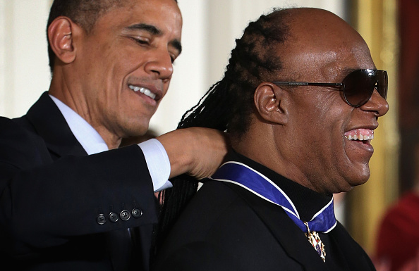 U.S. President Barack Obama (L) presents the Presidential Medal of Freedom to singer songwriter Stevie Wonder  (R) during an East Room ceremony at the White House November 24, 2014 in Washington, DC.
