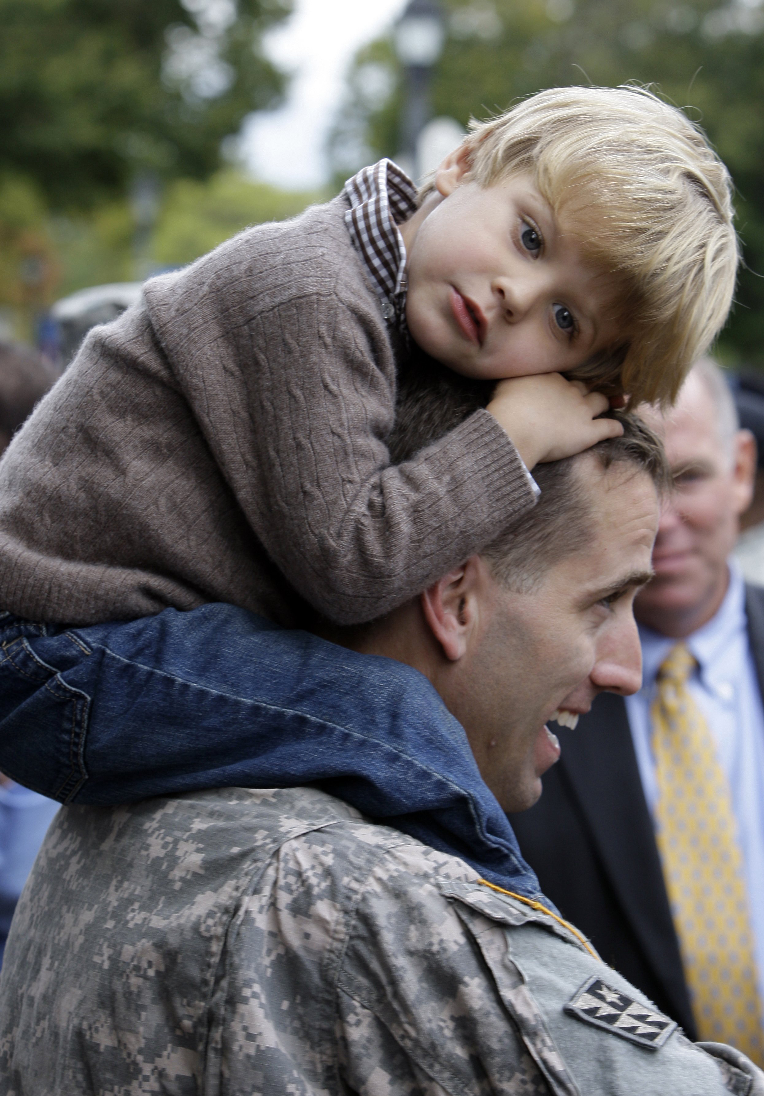 In this Sept. 30, 2009 file photo, Capt. Beau Biden carries his son Hunter, 3, on his shoulders after an official welcome home ceremony for members of the Delaware Army National Guard 261st Signal Brigade in Dover, Del.