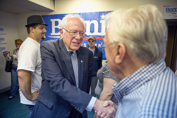 Democratic Presidential candidate and U.S. Sen. Bernie Sanders (I-VT) greets supporters during a visit to his Iowa campaign headquarters on June 13, 2015 in Des Moines, Iowa.