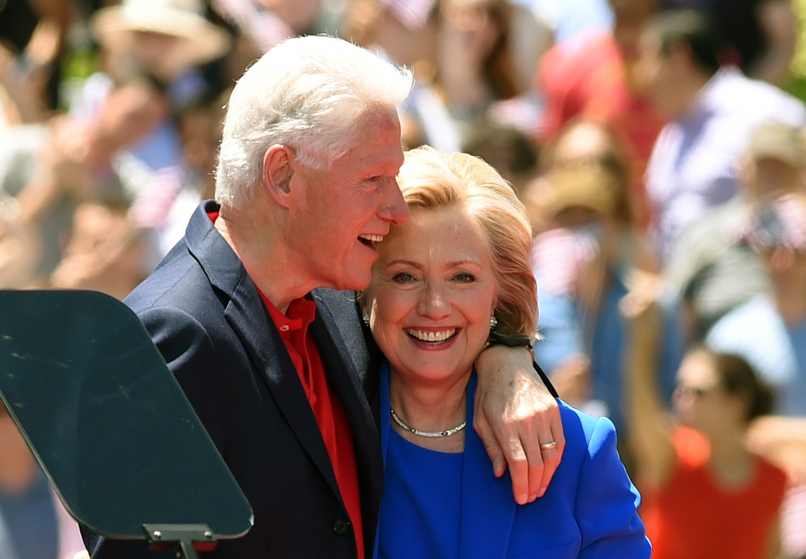 Former Secretary of State Hillary Clinton and Former US President Bill Clinton hug after she officially launched her campaign for the Democratic presidential nomination during a speech at the Franklin D. Roosevelt Four Freedoms Park on Roosevelt Island in New York, June 13, 2015 .