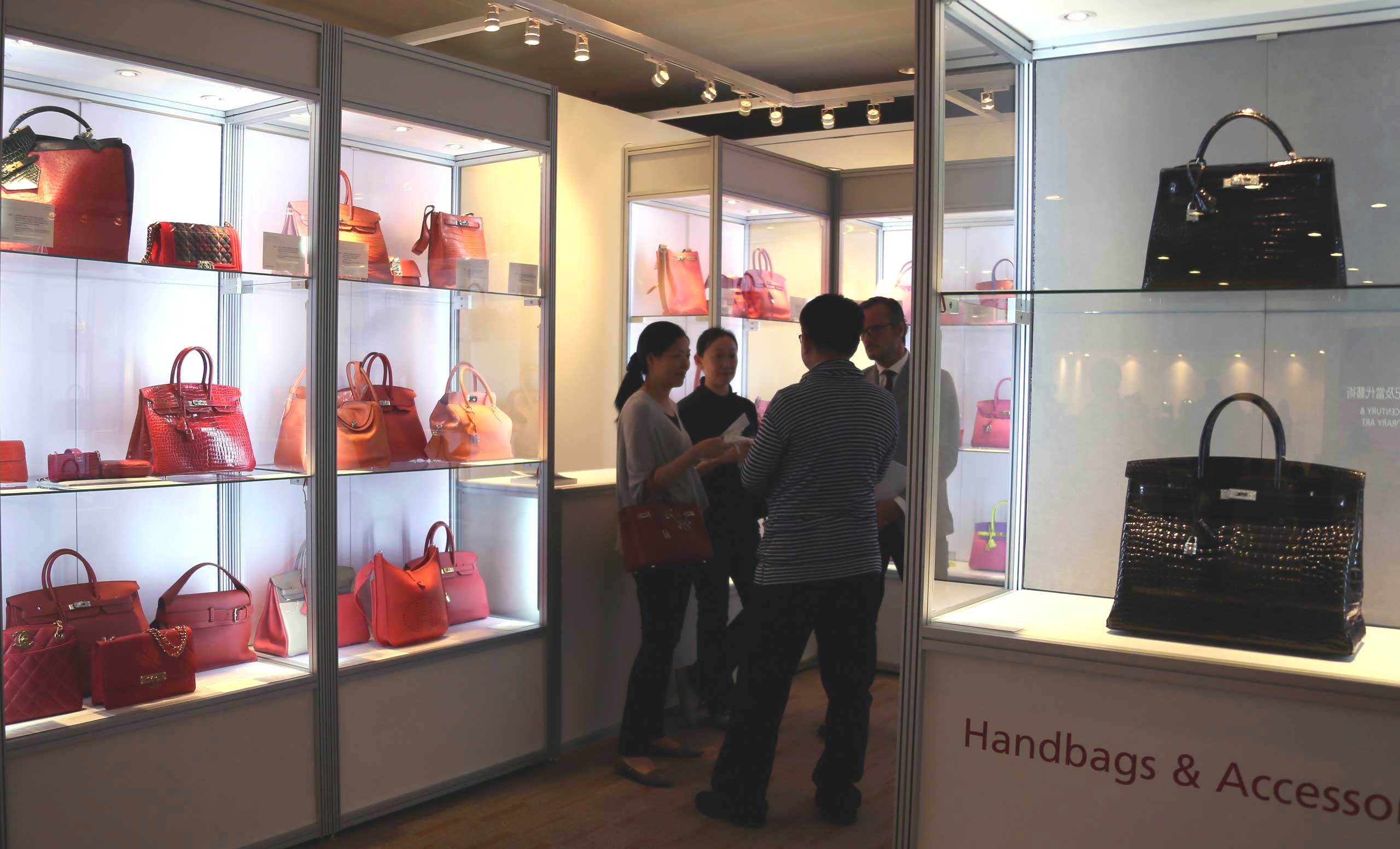 Visitors view the displayed expensive bags during the preview of Christie's Hong Kong 2015 spring season in Hong Kong on May 28, 2015.