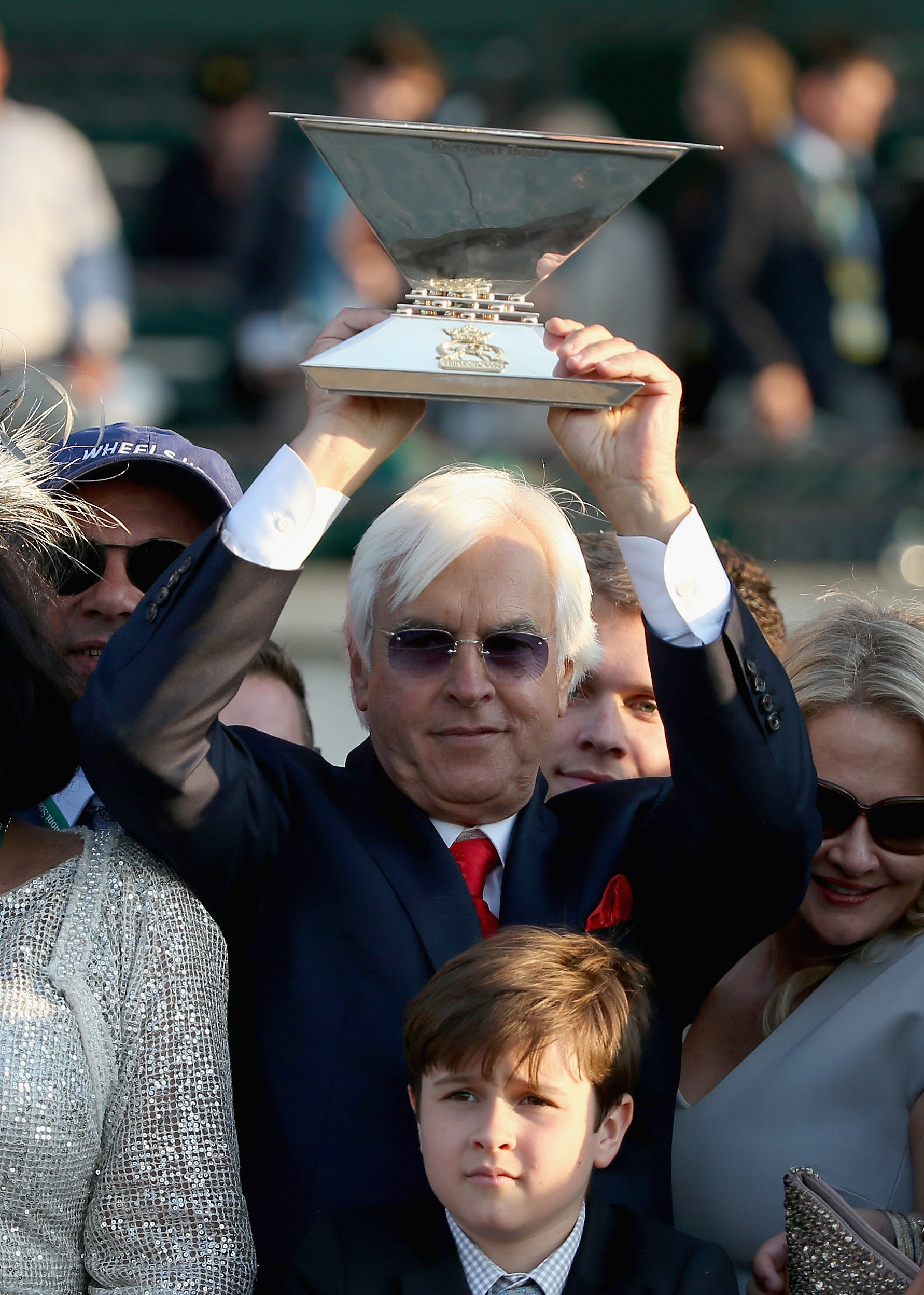 Trainer, Bob Baffert, of American Pharoah #5 celebrates with the Triple Crown Trophy after winning the 147th running of the Belmont Stakes at Belmont Park on June 6, 2015 in Elmont, N.Y.