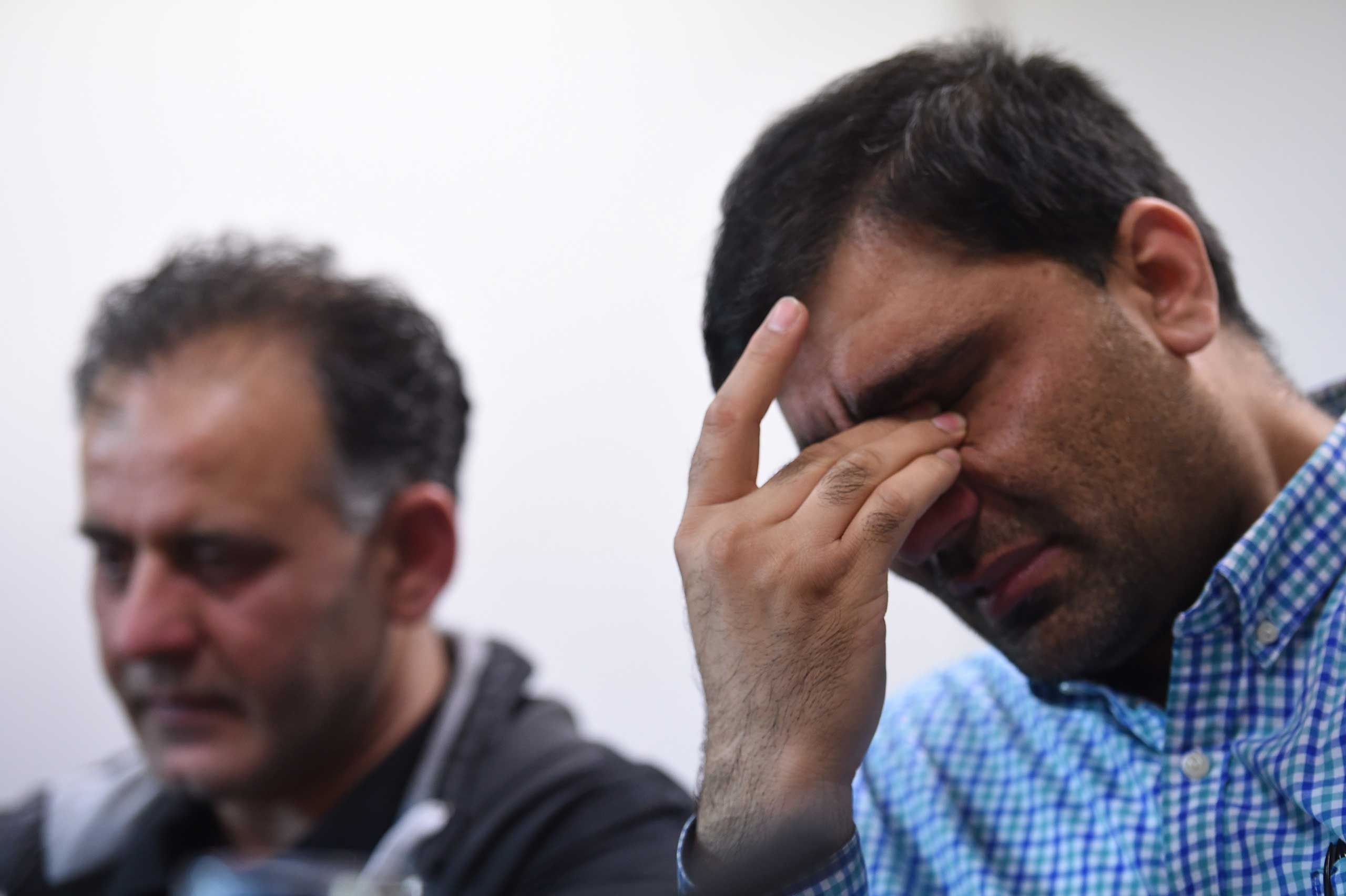 Akhtar Iqbal, husband of Sugra Dawood, left, and Mohammad Shoaib, husband of Khadija Dawood, react during a news conference to appeal for their return, in Bradford, northern England on June 16, 2015.