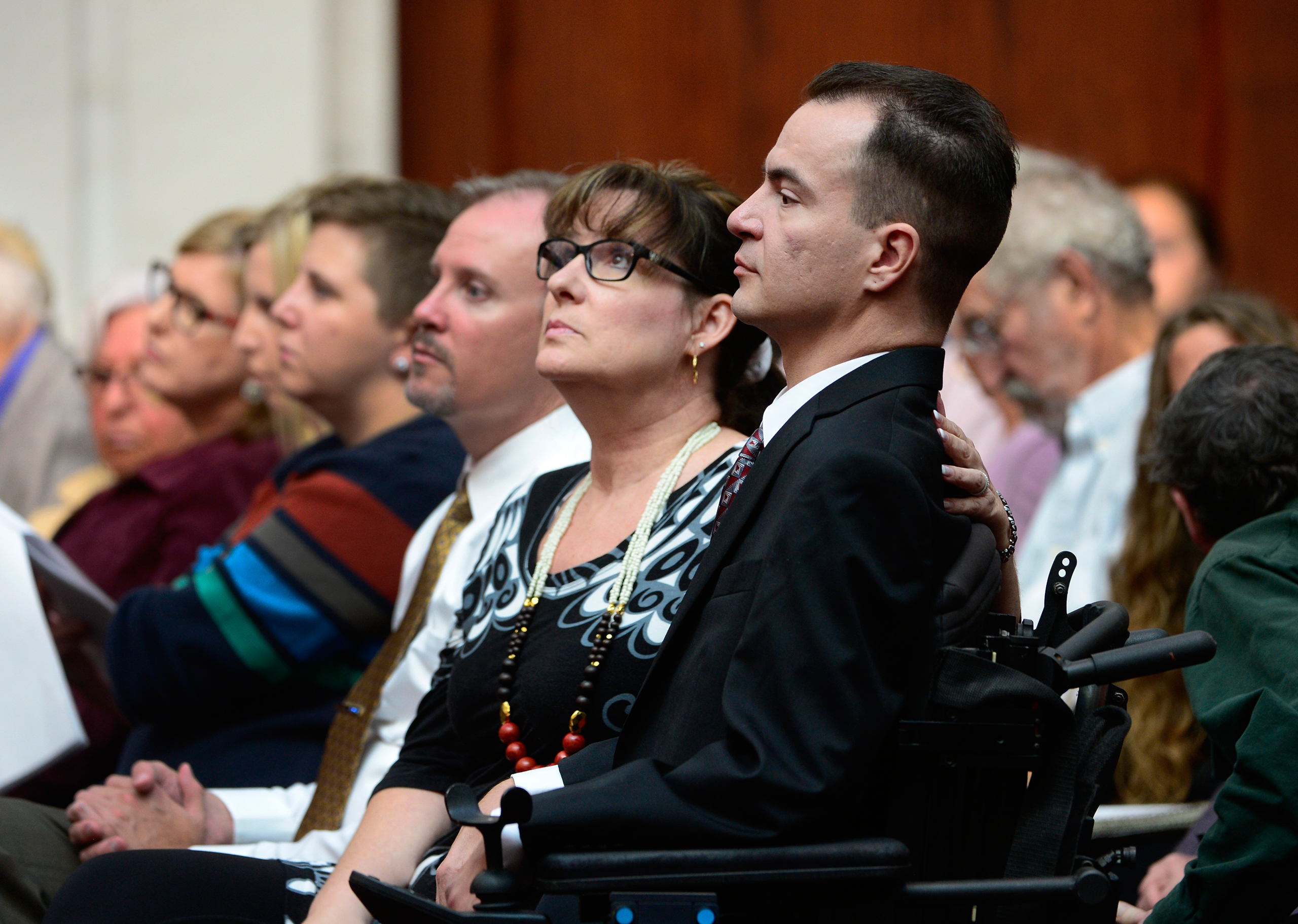 Brandon Coats, right, with his mother Donna Scharfenberg sitting by his side, Sept. 30, 2014.