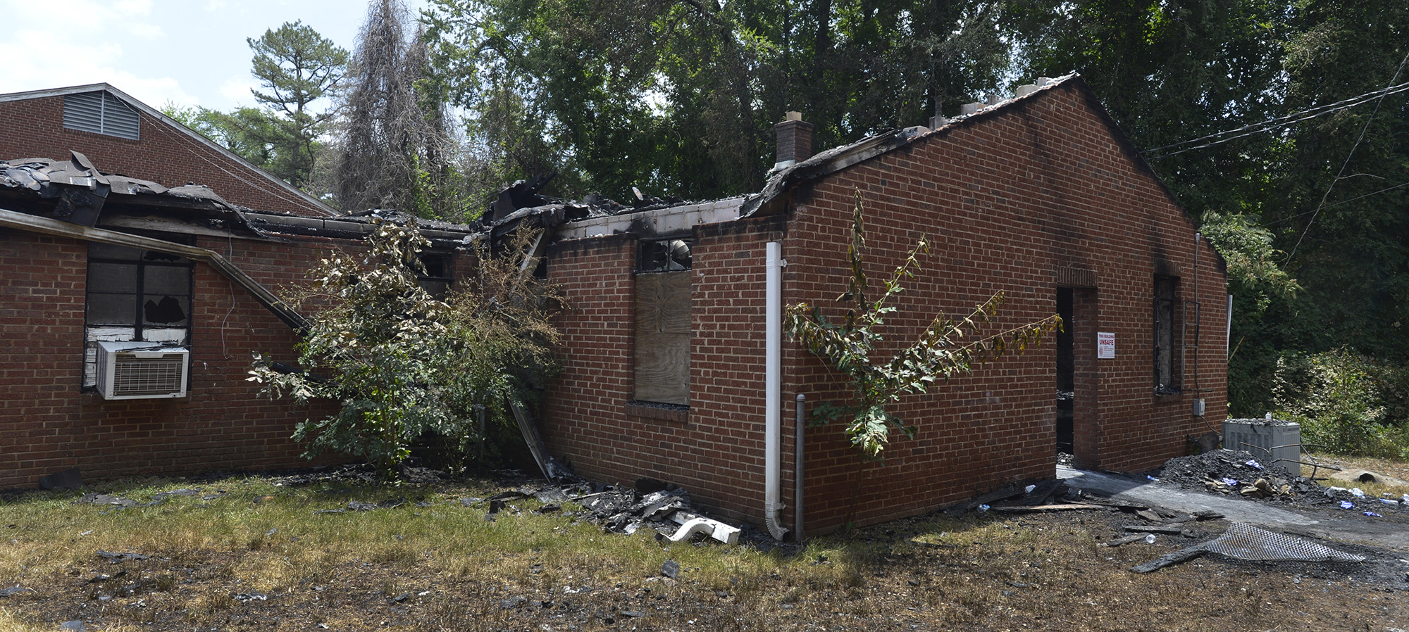 This June 24, 2015 photo shows the charred remains of the back left wing of Briar Creek Road Baptist Church in Charlotte, N.C.