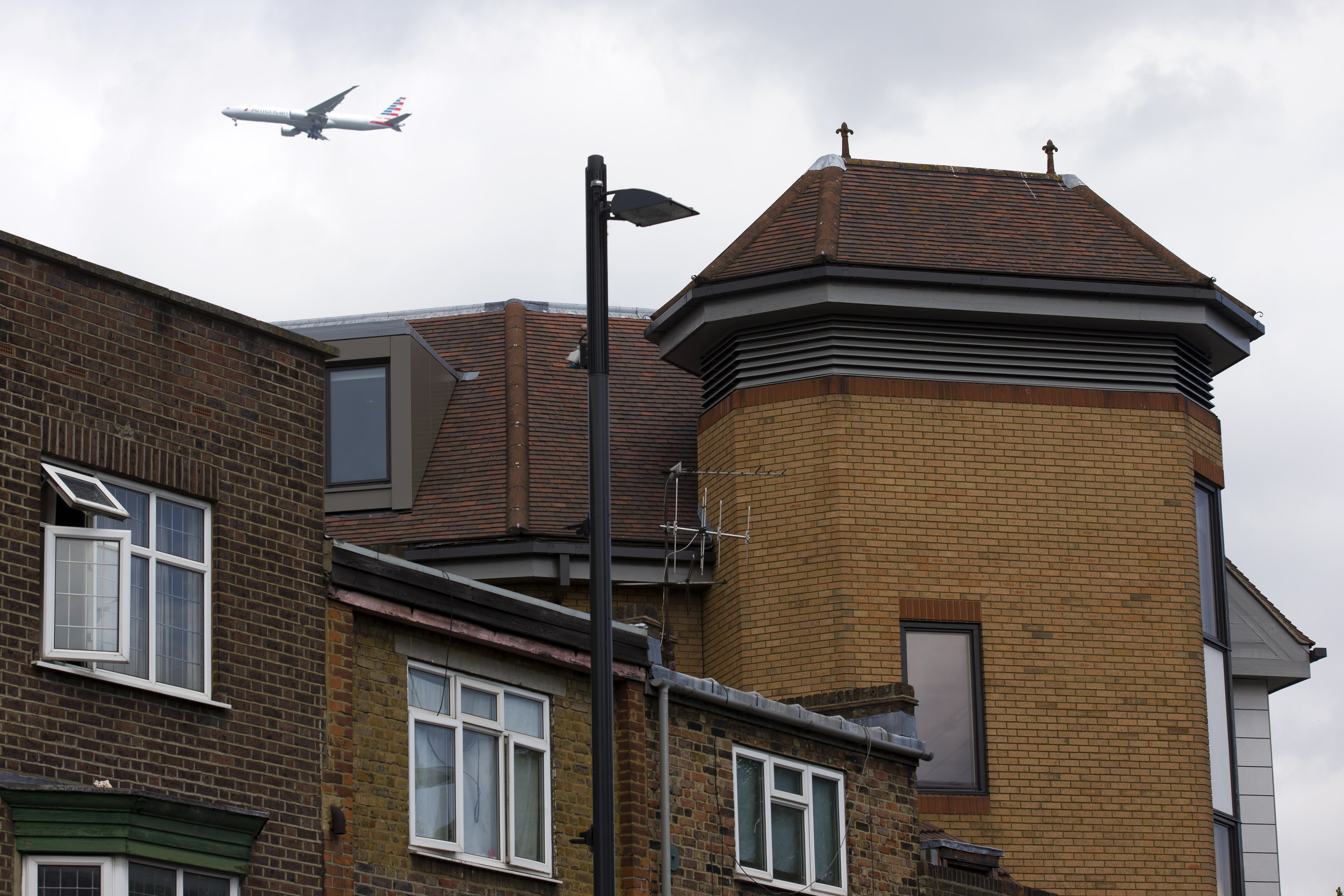 An airplane flying on June 19, 2015, past the offices of notonthehighstreet.com, an online retailer in Richmond, London, where the body of a dead man was found on the roof on June 18