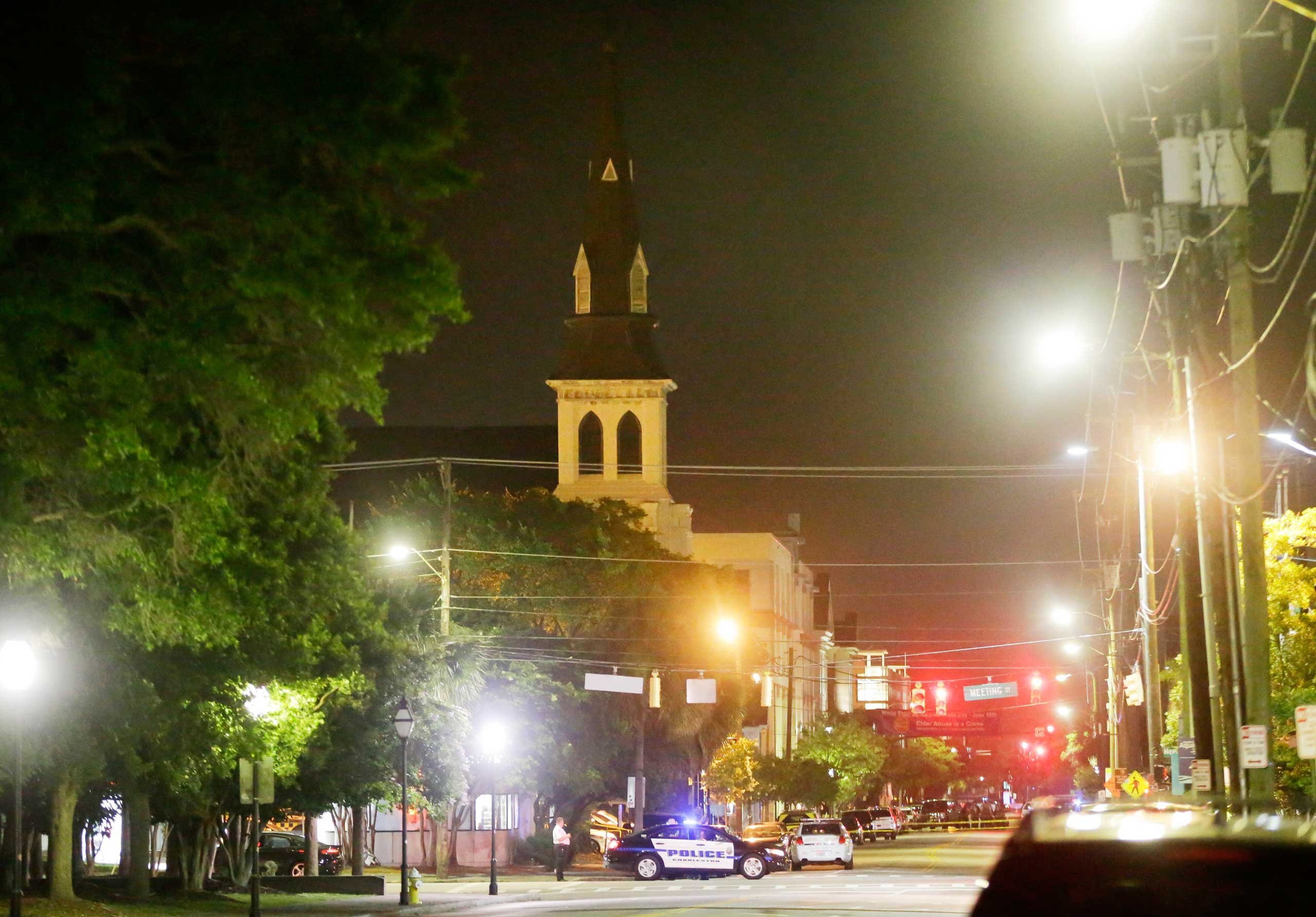 The steeple of Emanuel AME Church is visible as police close off a section of Calhoun Street early on June 18, 2015 following a shooting Wednesday night in Charleston, S.C.