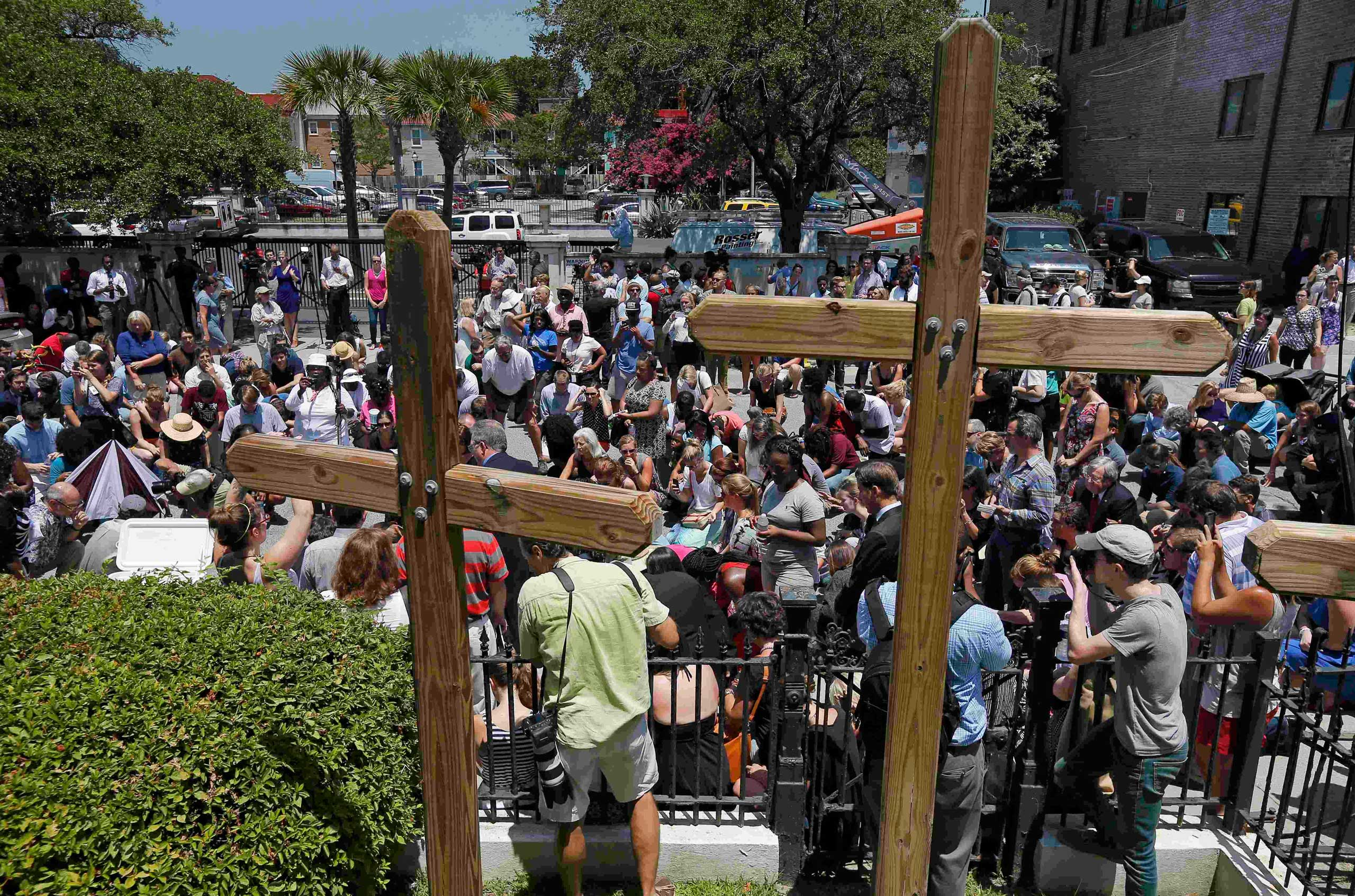 Mourners gather outside Morris Brown AME Church for a vigil one day after a mass shooting in Charleston, S.C., on June 18, 2015.