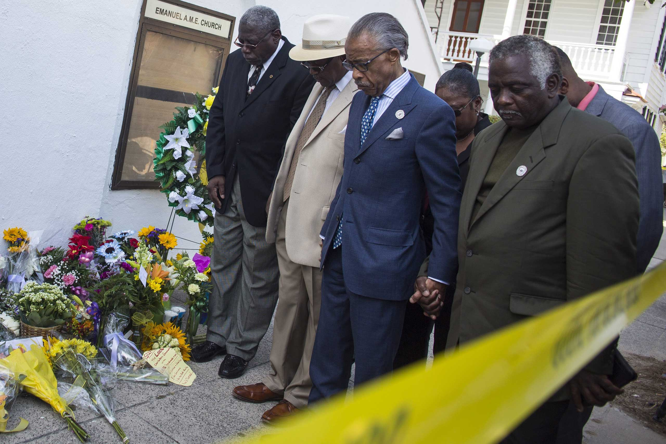 Reverend Al Sharpton visits the memorial site at the Emanuel African Methodist Episcopal Church where nine people were murdered in Charleston, S.C., on June 18, 2015.