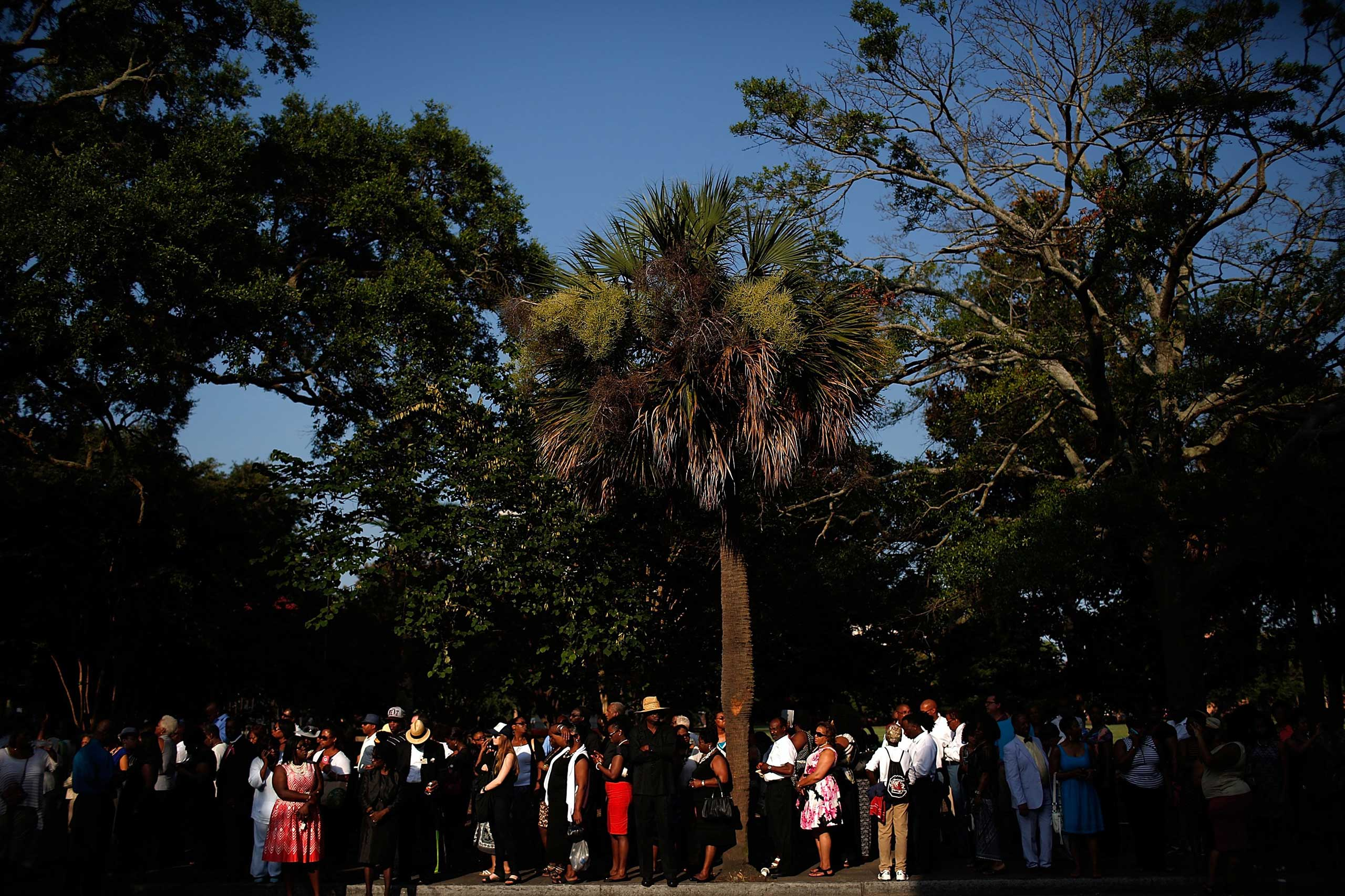 People wait in line to enter the funeral service Rev. Clementa Pinckney in Charleston, S.C. on June 26, 2015.