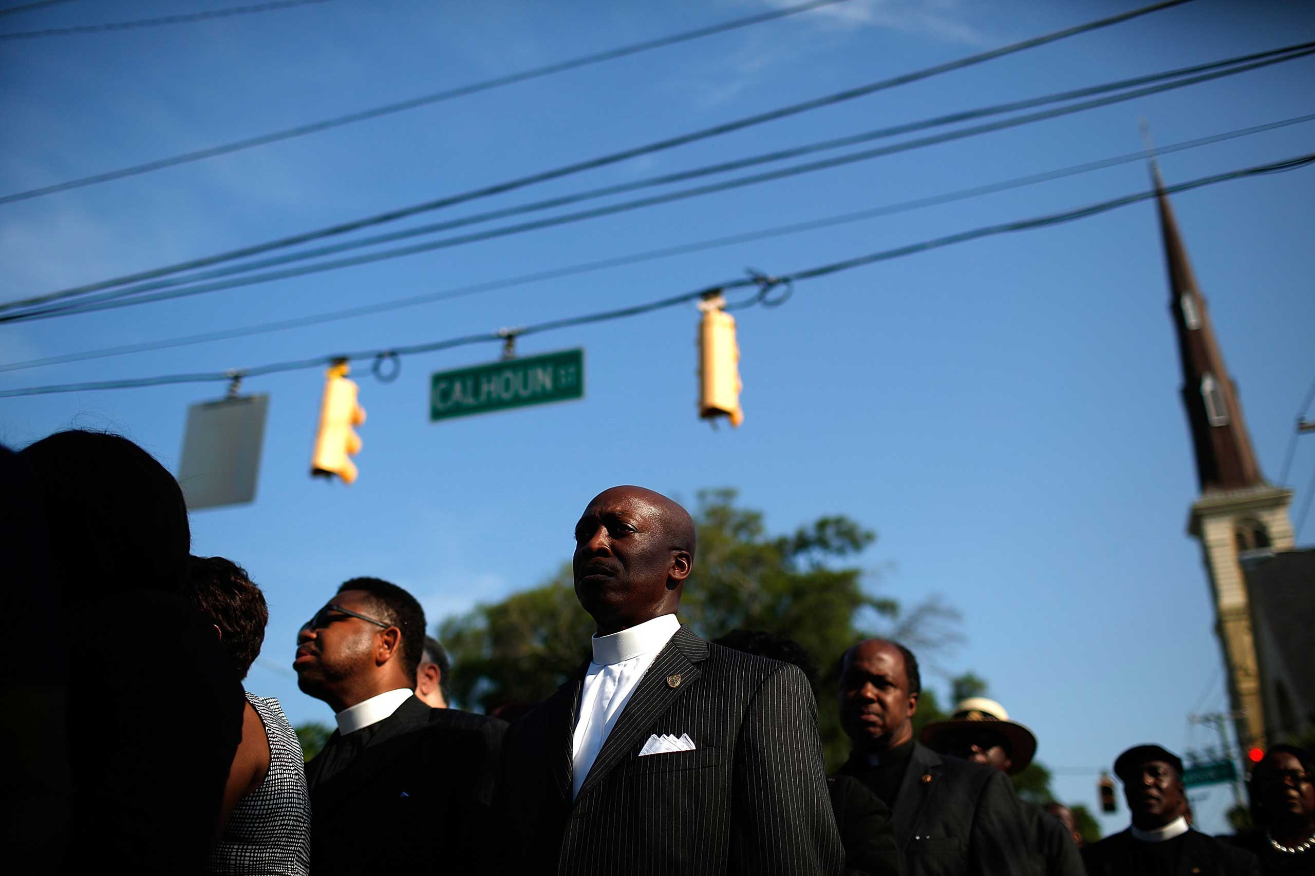 Members of the clergy wait to enter the funeral service for Rev. Clementa Pinckney in Charleston, S.C. on June 26, 2015.