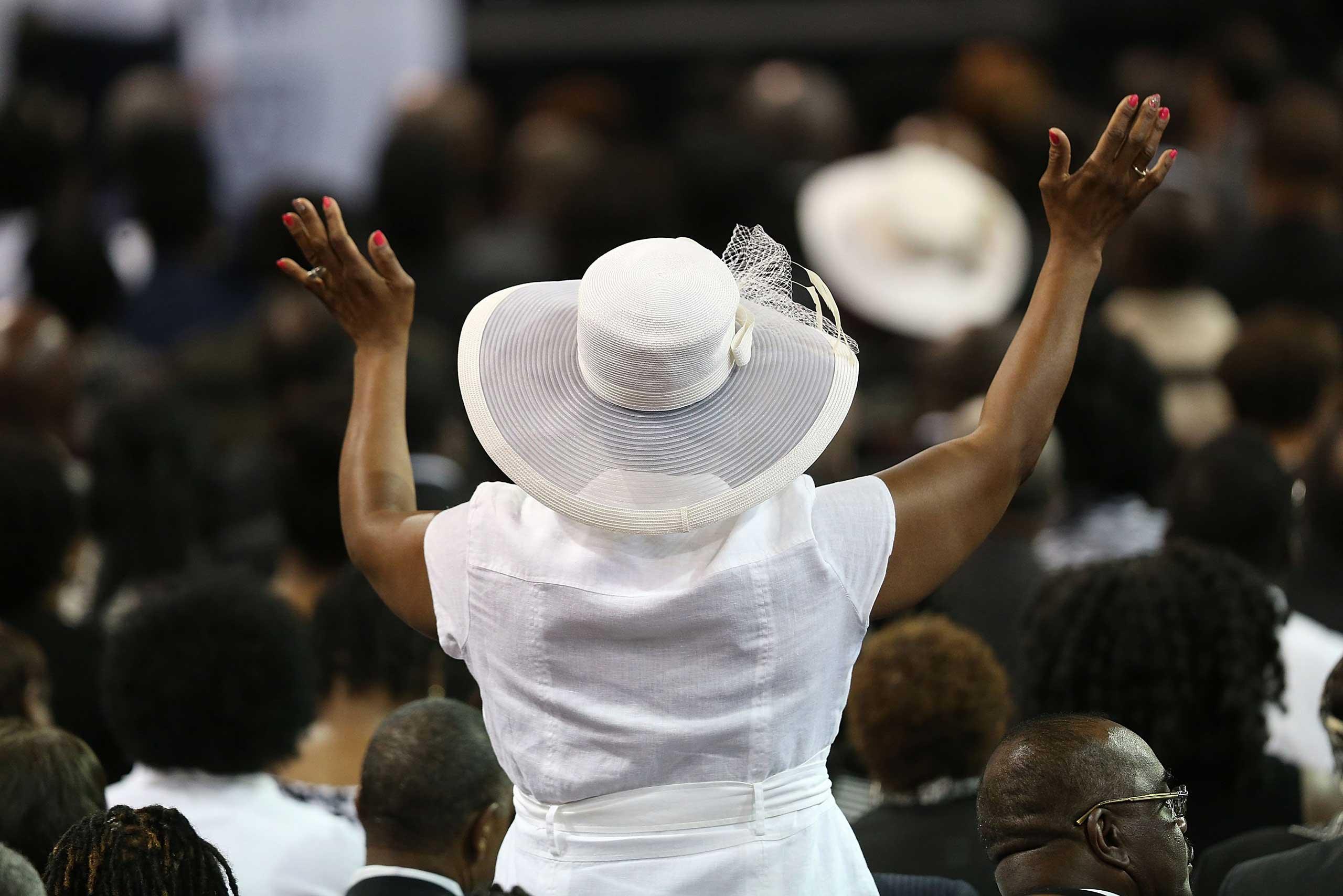 Mourners attend the funeral of Rev. Clementa Pinckney at College of Charleston TD Arena in Charleston, S.C. on June 26, 2015.