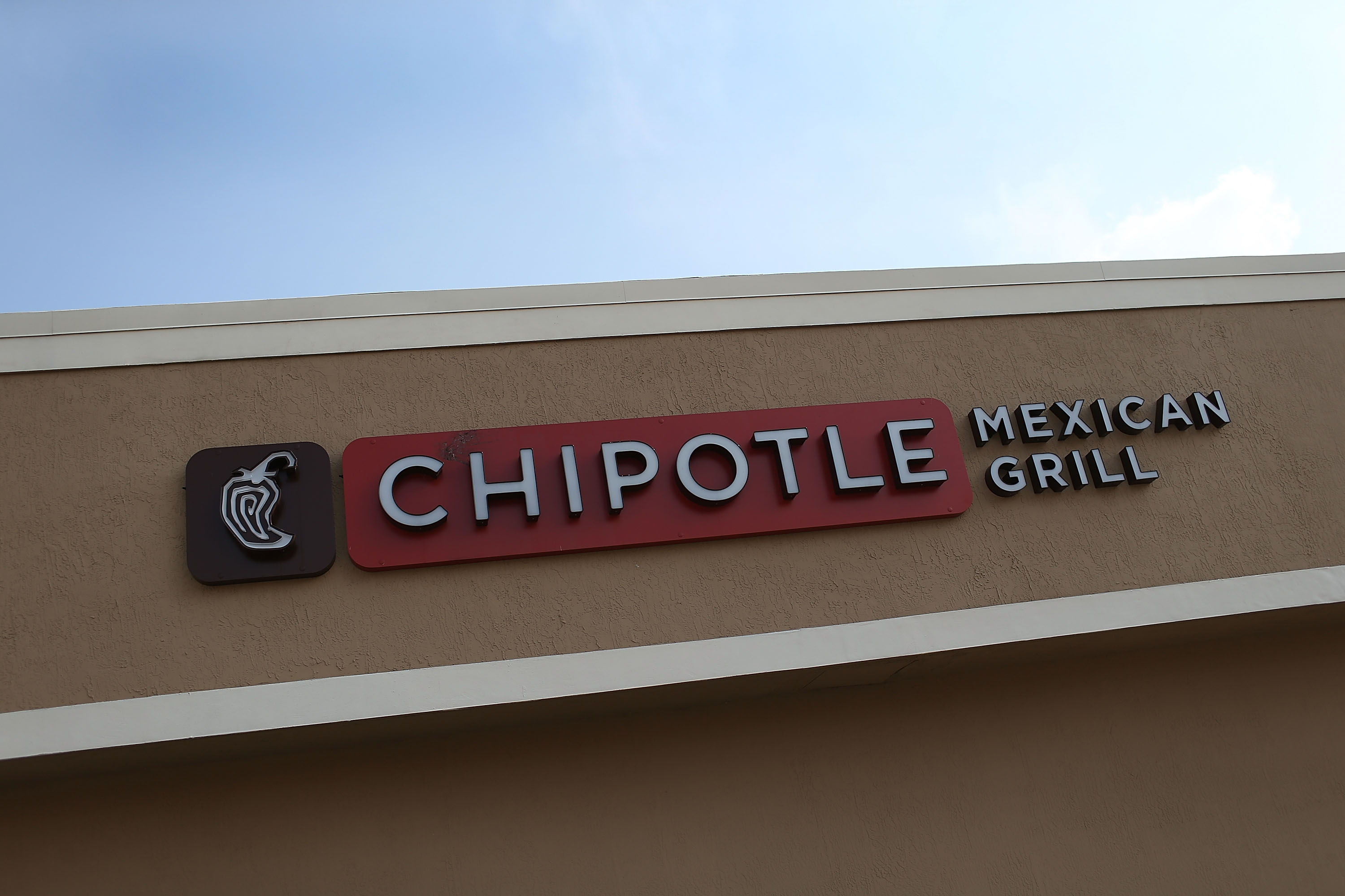 The sign is seen outside the Chipotle restaurant, on the day that the company announced it will only use non-GMO ingredients in its food on April 27, 2015 in Miami.