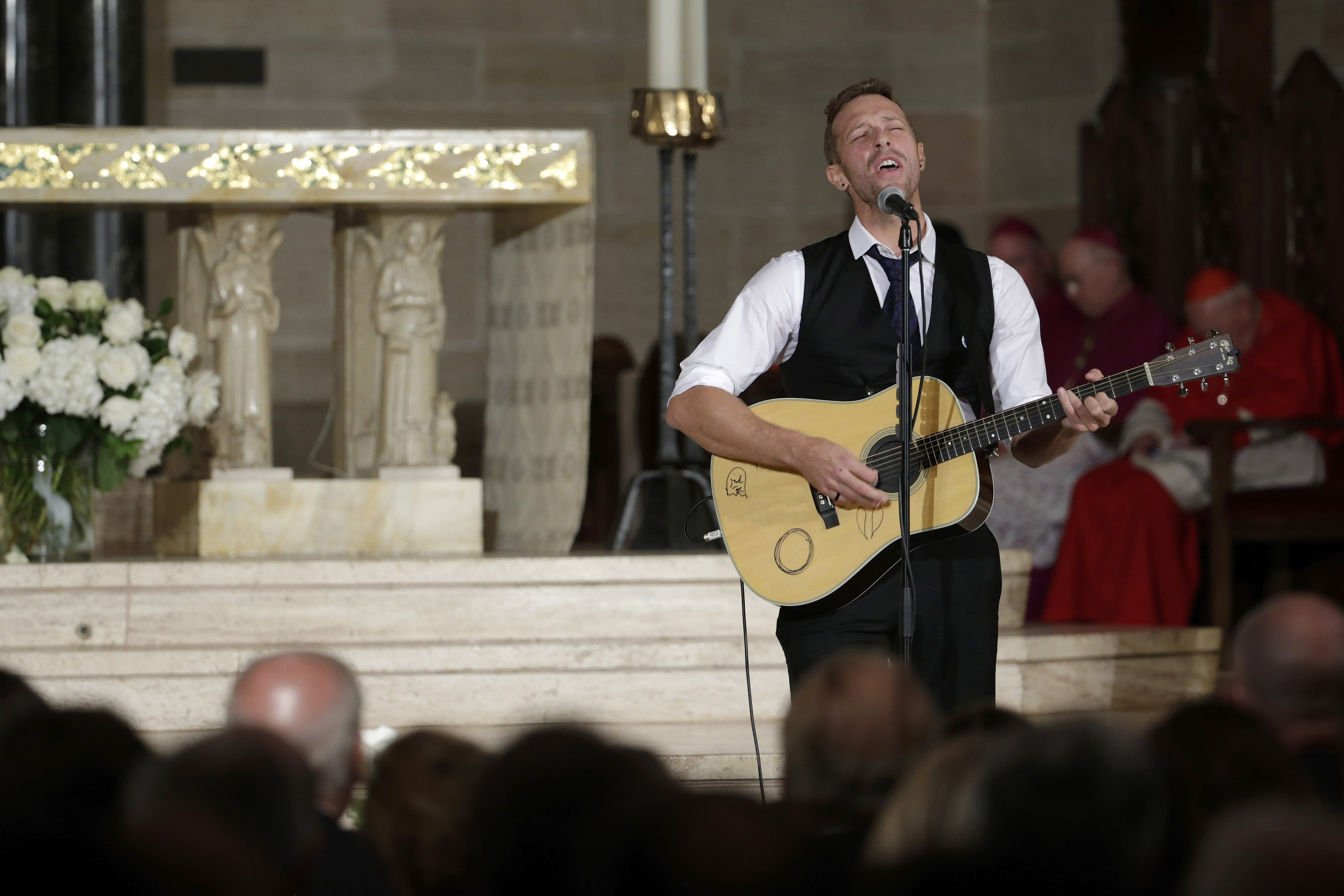 Chris Martin on the group Coldplay performs  Til Kingdom Comes  during funeral services for Vice President Joe Biden's son, former Delaware Attorney General Beau Biden, at St. Anthony of Padua Church in Wilmington, Del., on June 6, 2015.