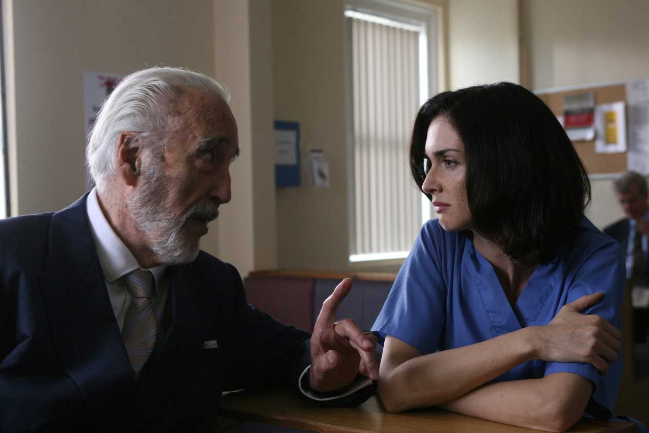 Christopher Lee and Paz Vega in Triage (2009).