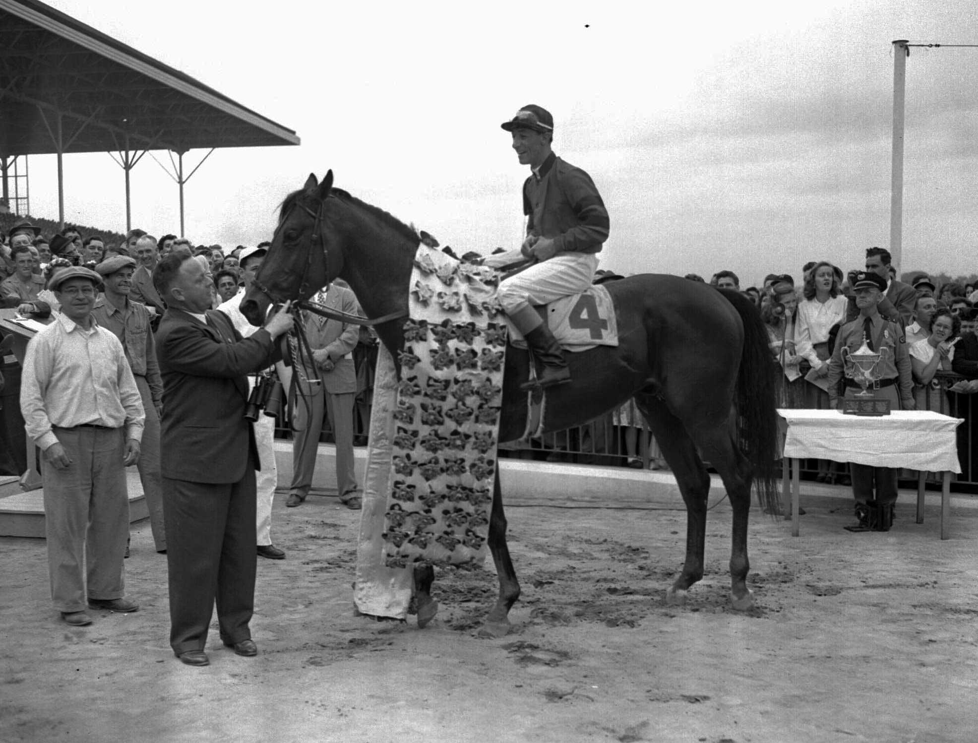 1948: Citation with jockey Eddie Arcaro