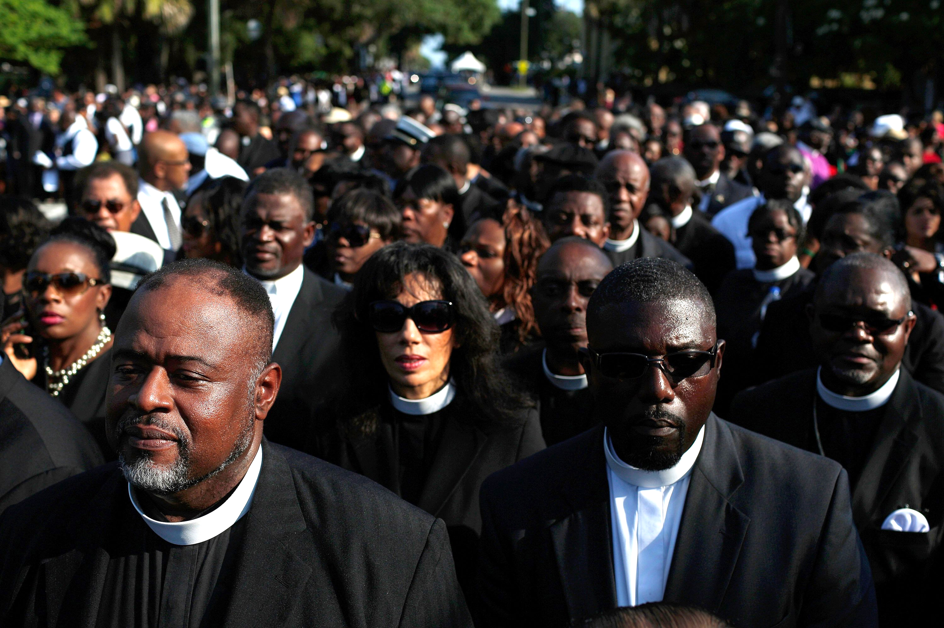 Members of the clergy wait to enter the funeral service where U.S. President Barack Obama will deliver the eulogy for South Carolina State senator and Rev. Clementa Pinckney who was killed along with eight others in a mass shooting June 26, 2015 in Charleston, S.C.