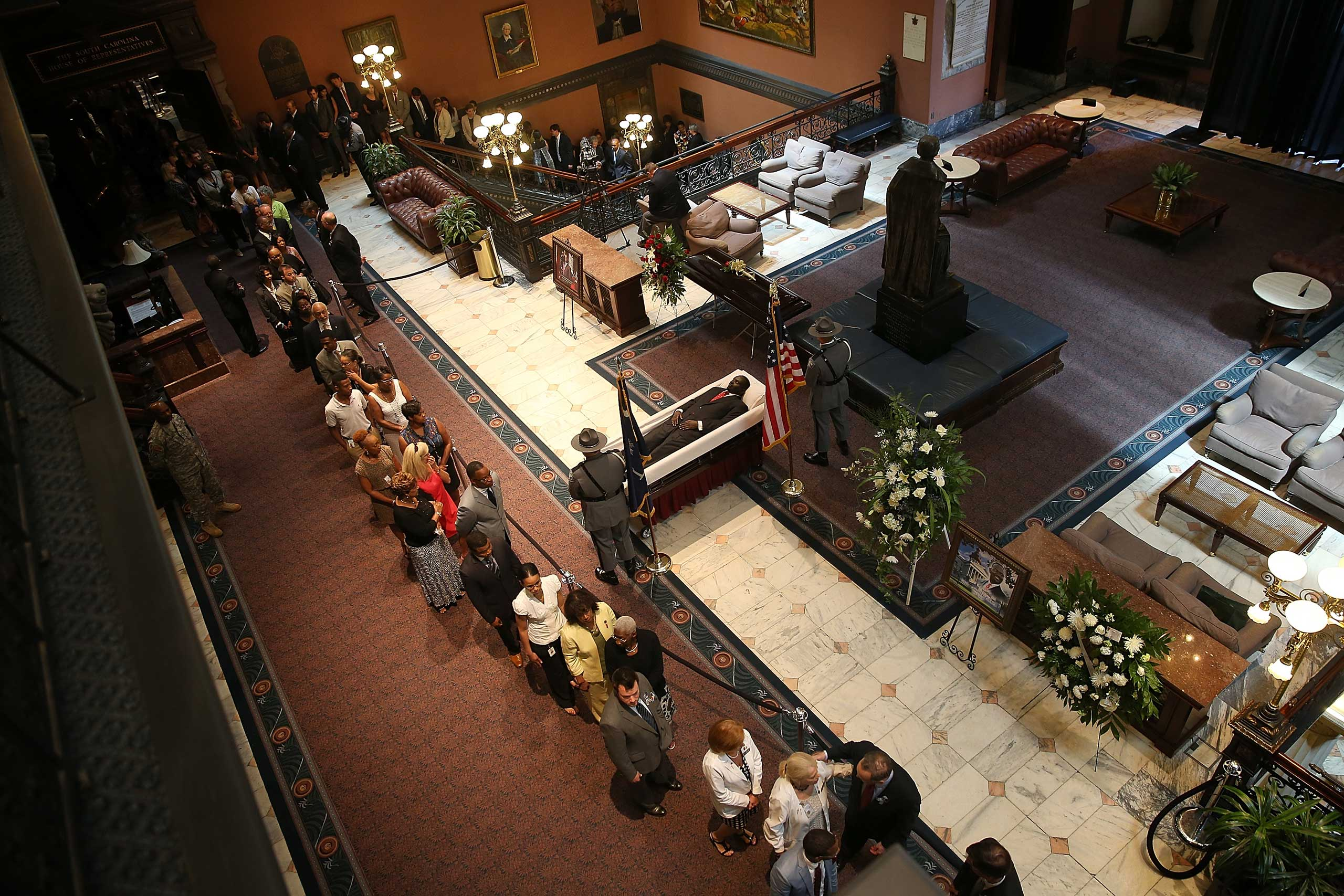 Visitors pay their respects during an open viewing for Rev. Clementa Pinckney at the South Carolina State House in Columbia, S.C. on June 24, 2015.