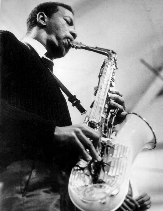 Ornette Coleman performs onstage with his saxophone circa 1960.