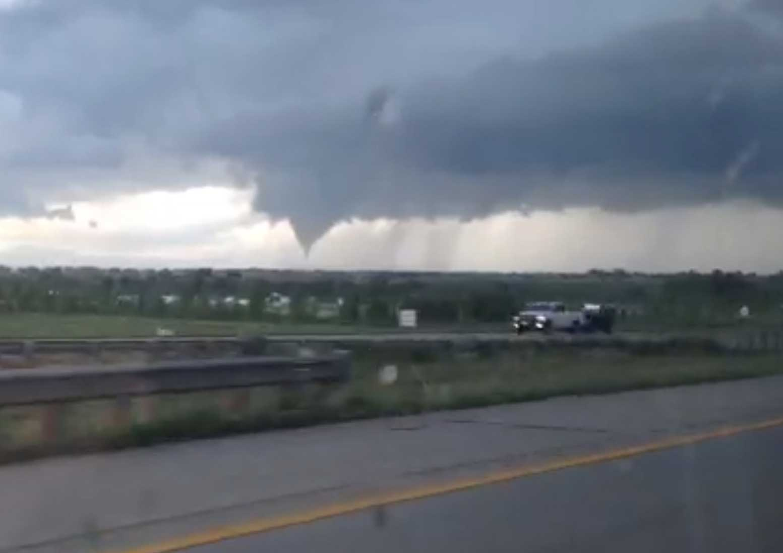 In this frame from video, a tornado moves through Longmont, Colo., June 4, 2015.