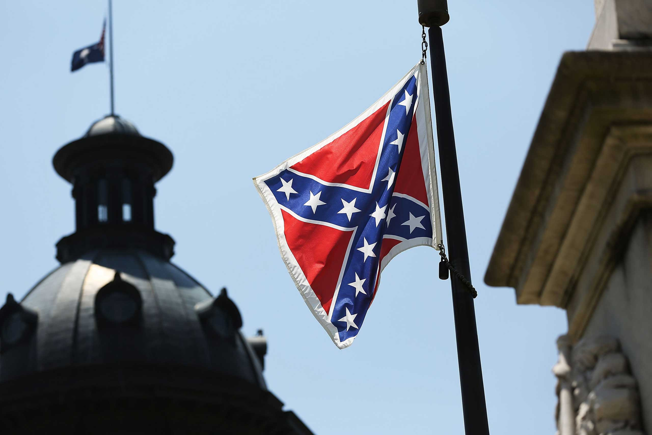 The Confederate flag is seen flying on the Capitol grounds a day after South Carolina Gov.