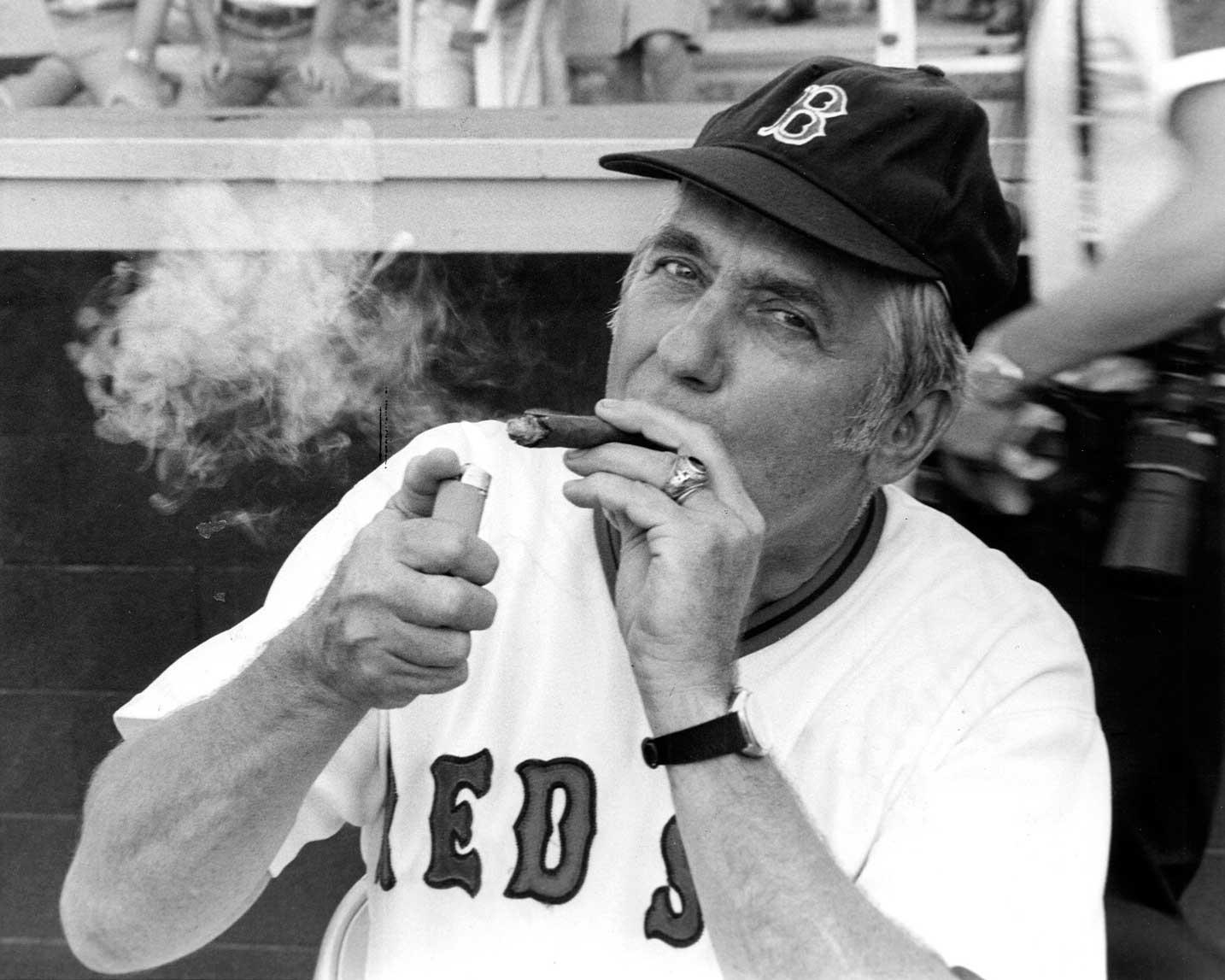Silvio O. Conte, R-Mass., lights a victory cigar after Republicans won the 1975 Congressional Baseball game.