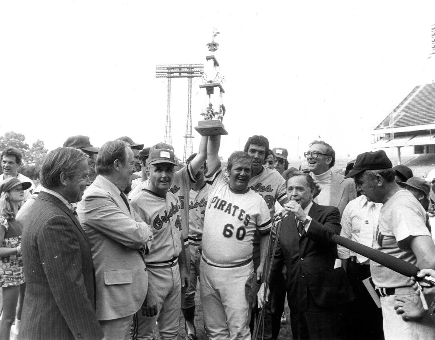 Democratic Team Manager Bill Chappell and Mendel Davis hold the Roll Call trophy after winning the Congressional Baseball Game of 1975.