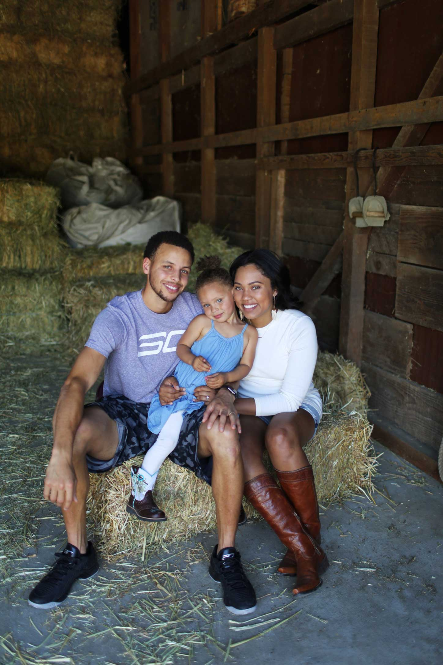 Ayesha and Stephen Curry with their daughter Riley in 2015.