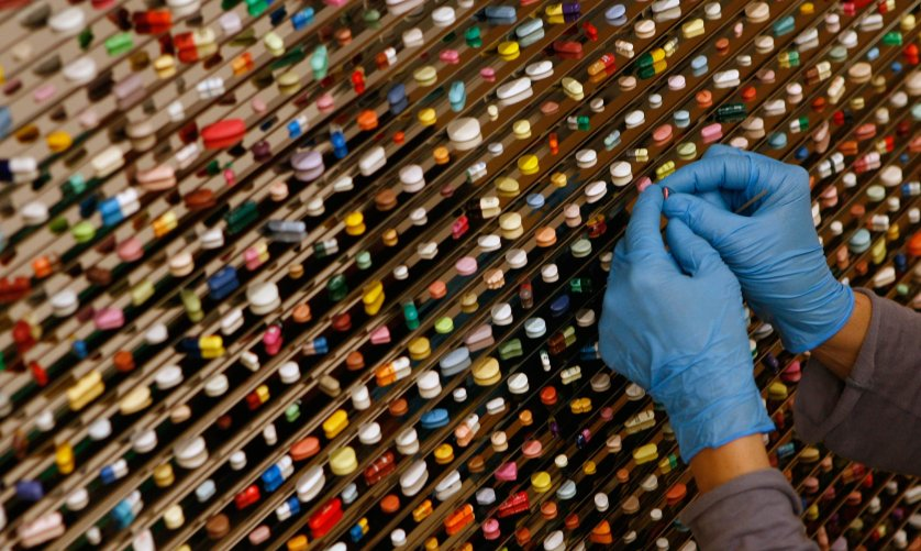 An art handler places drugs for an art installation of British artist Hirst in the new Brandhorst modern art museum in Munich
