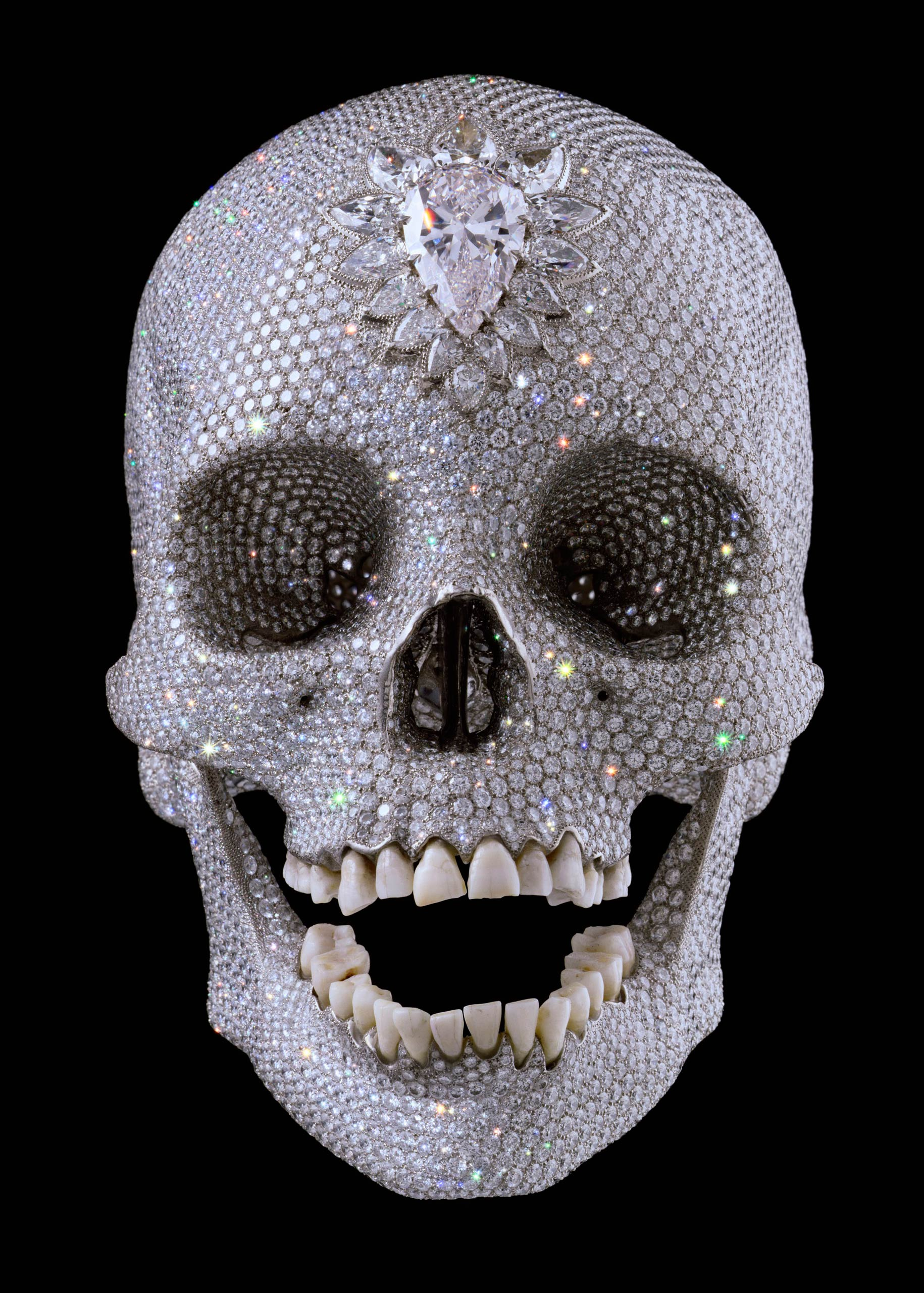 Another signature Hirst is the diamond-encrusted platinum skull,  For the Love of God  (2007), with original 18th-century human teeth.