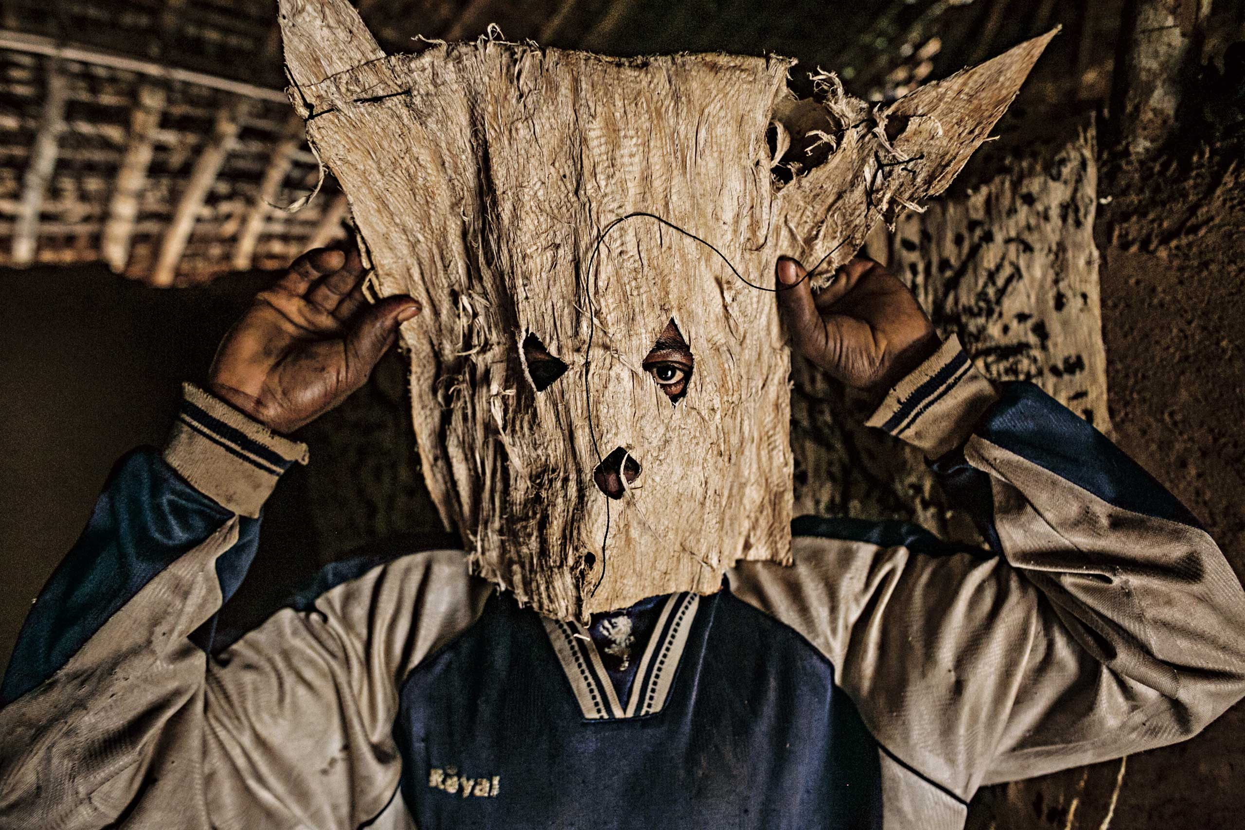 From the July issue of National Geographic magazine: Seeking the Source of Ebola                               A hunter from a small village in the Democratic Republic of the Congo (DRC) adjusts the mask that he'll wear while stalking game. The consumption of infected bush meat is one way Ebola virus passes to humans.