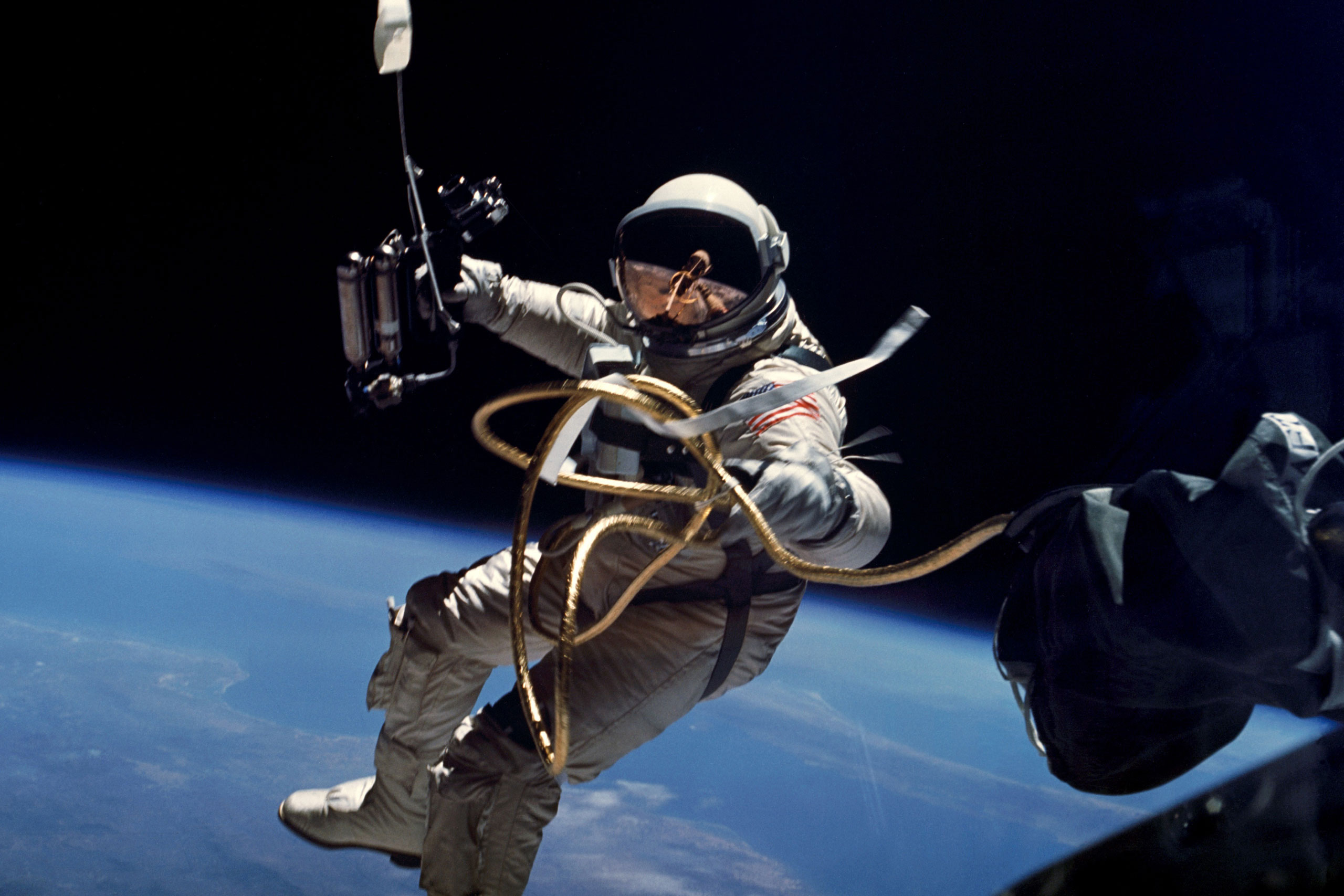 Astronaut Edward H. White II, pilot for the Gemini-Titan 4 space flight, floats in space during America's first spacewalk on June 3, 1965
