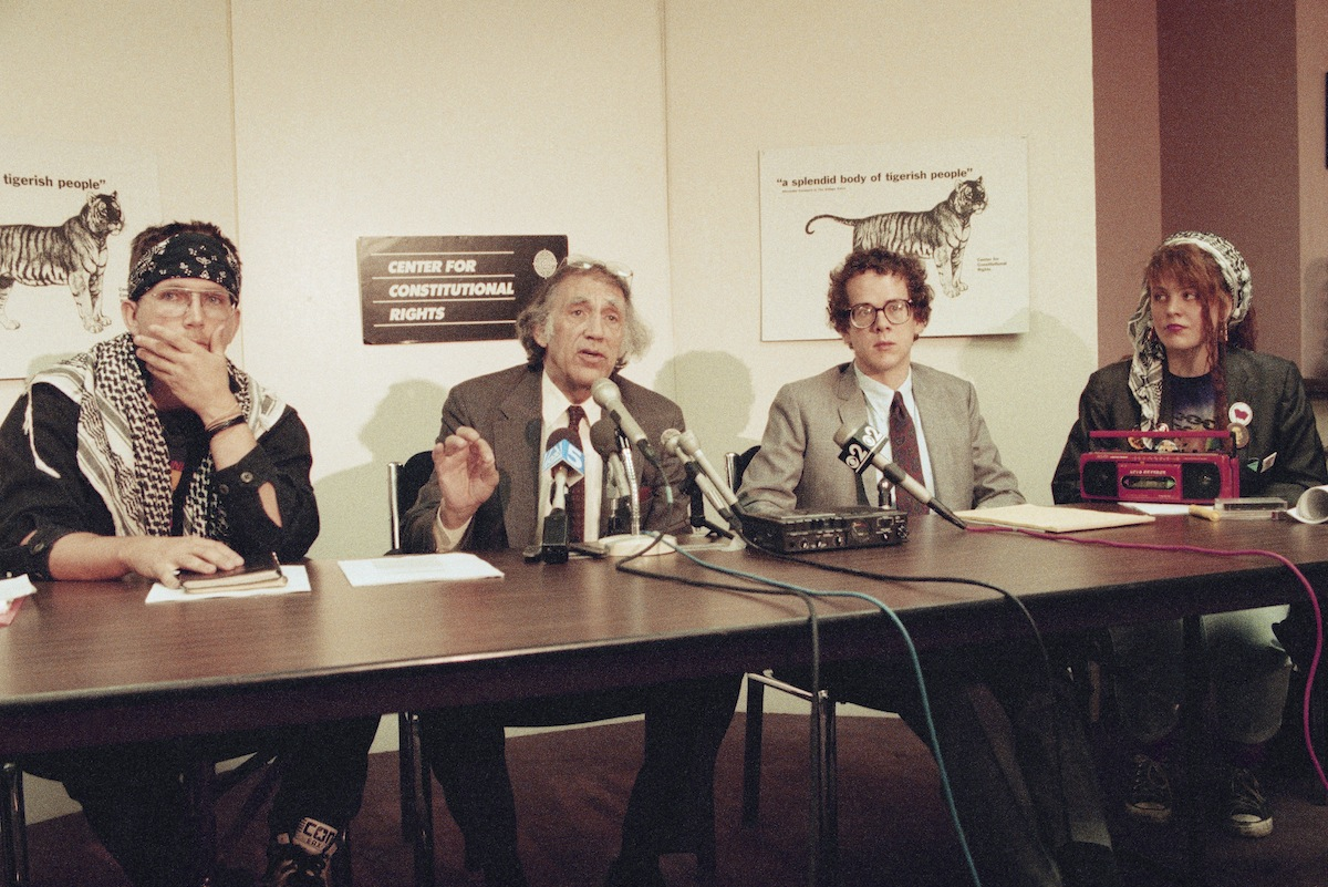 William Kunstler second from left, discusses the Supreme Court ruling to declare the Flag Protection Act of 1989 unconstitutional at a press conference on June 11, 1990 in New York, Kunstler and David Cole, second from right, represented Shawn Eichman, right, a defendant in the case, and Joey Johnson, a defendant in a similar case in 1989.