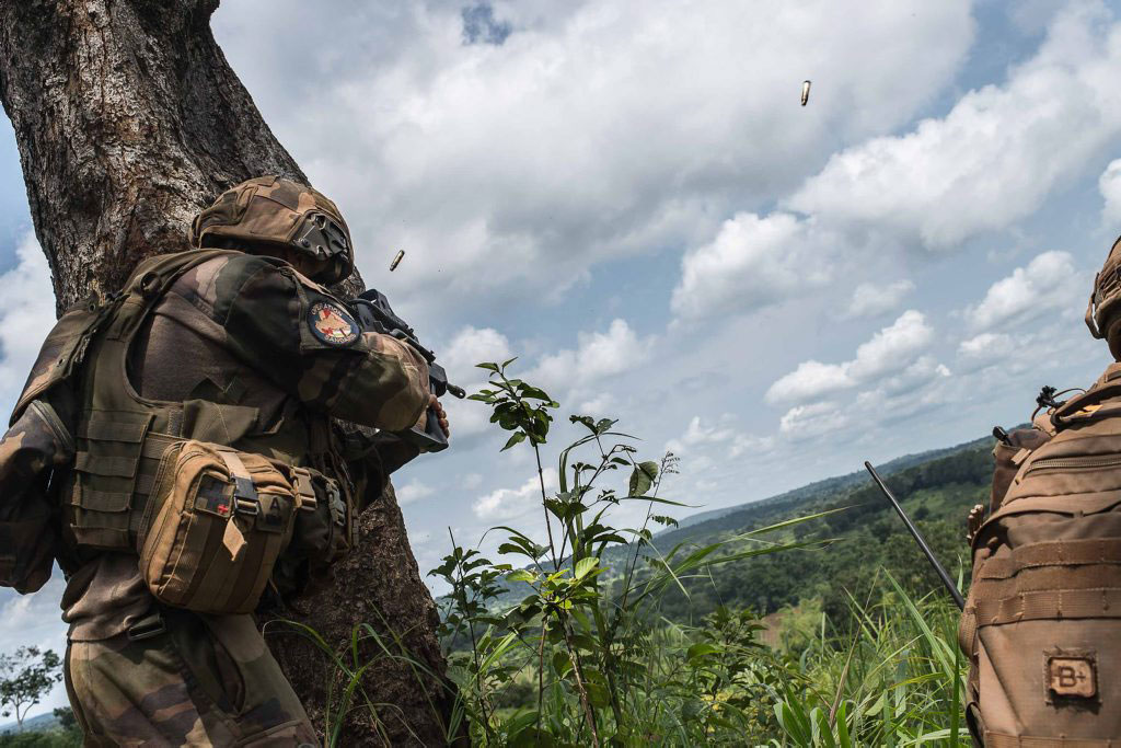 A French Foreign Legion soldier is firing at an enemy position.