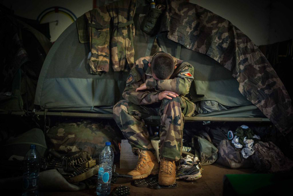 An exhausted French Foreign Legion soldier is taking rest after a patrol on Aug. 19, 2014.