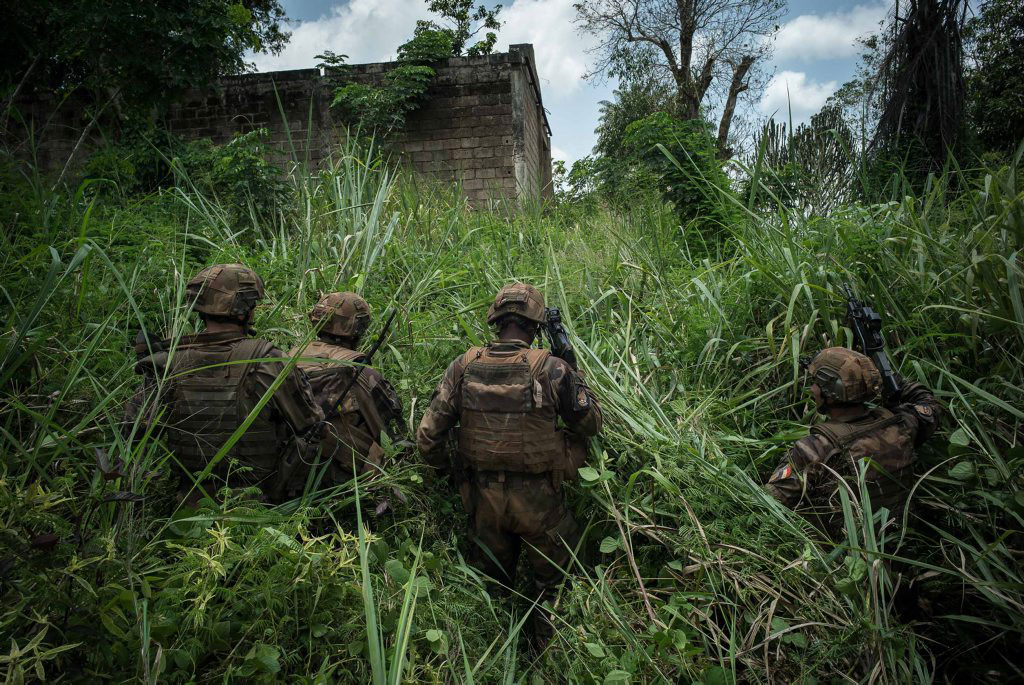 French Foreign Legion soldiers are searching for armed people who fired on their positions on Aug. 26, 2014.