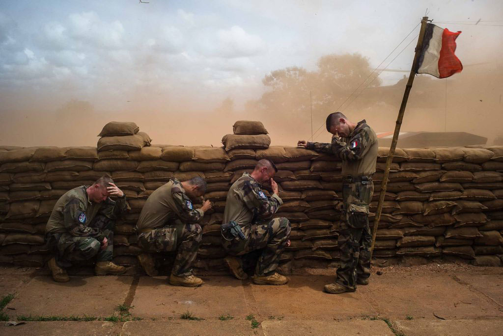 French Foreign Legion soldiers are hiding behind sandbags on Aug. 16, 2014.