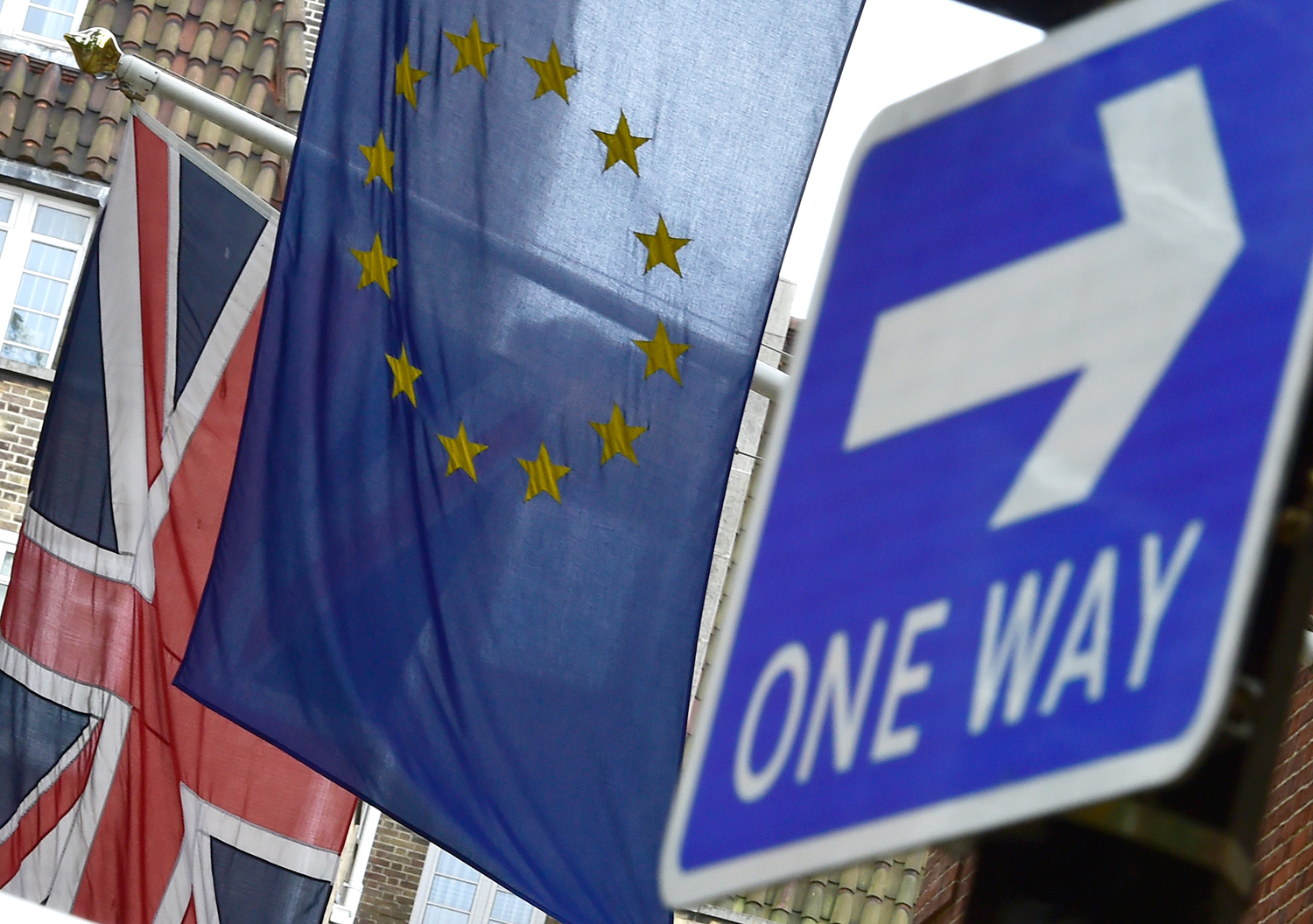 The British Union flag and European Union flag are seen hanging outside Europe House in central London on June 9, 2015.