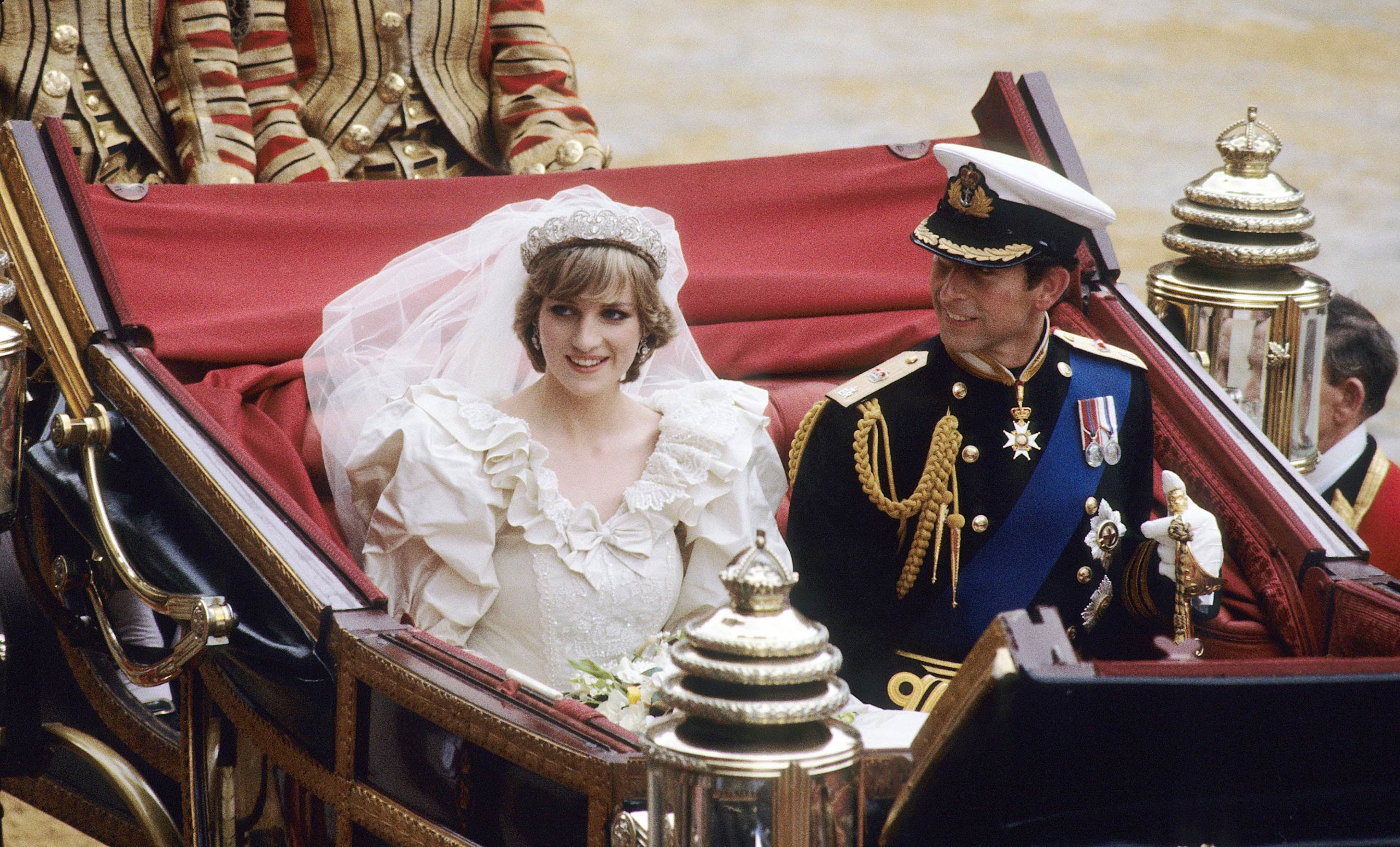 Diana, Princess of Wales and Prince Charles ride in a carriage after their wedding at St. Paul's Cathedral July 29, 1981 in London.