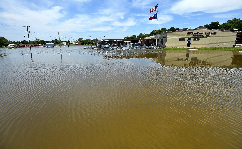 Flood waters surround the Bridgeport Building Center in Bridgeport, Texas, June 1, 2015.