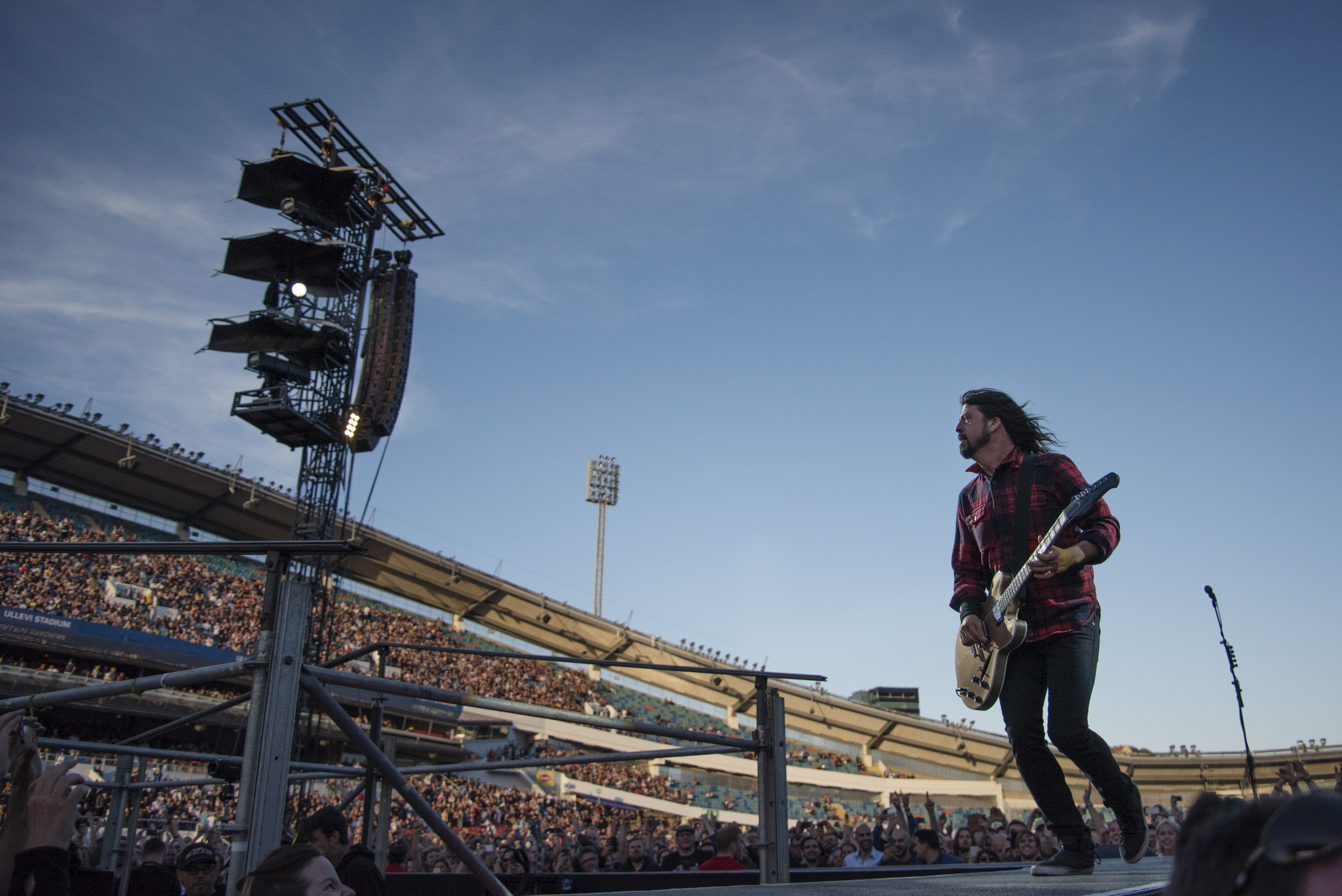 Foo Fighters band member Dave Grohl performs during the band's concert at Nya Ullevi in Gothenburg, Sweden, on June 12, 2015, before falling off the stage.
